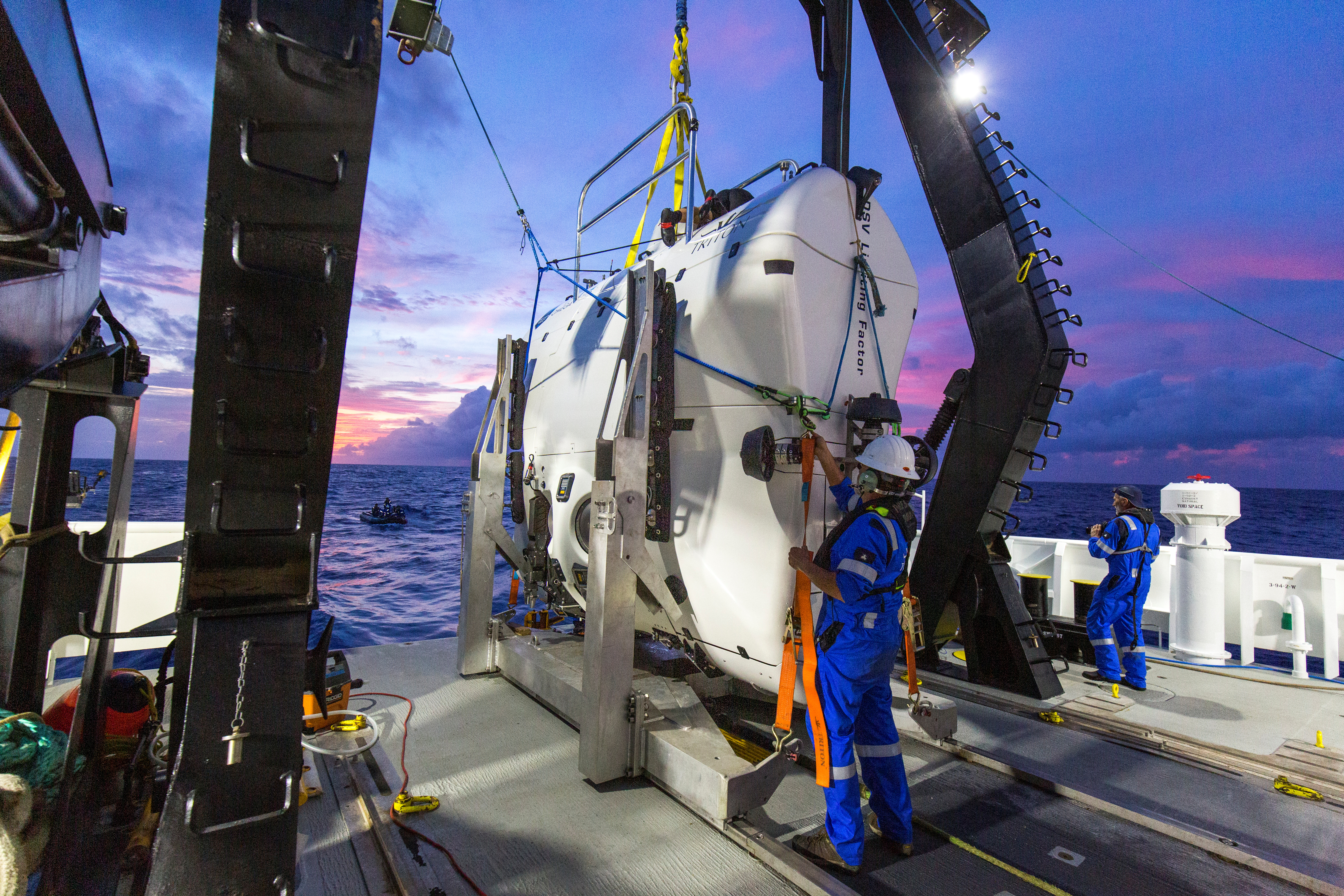 A technician checks the submarine DSV Limiting Factor aboard the research vessel DSSV Pressure Drop above the Pacific Ocean's Mariana Trench in an undated photo released by the Discovery Channel May 13, 2019. Atlantic Productions for Discovery Channel/Tamara Stubbs/Handout via REUTERS. ATTENTION EDITORS - THIS IMAGE WAS PROVIDED BY A THIRD PARTY. NO ARCHIVE. NO RESALES. MANDATORY CREDIT. - RC19891EC880