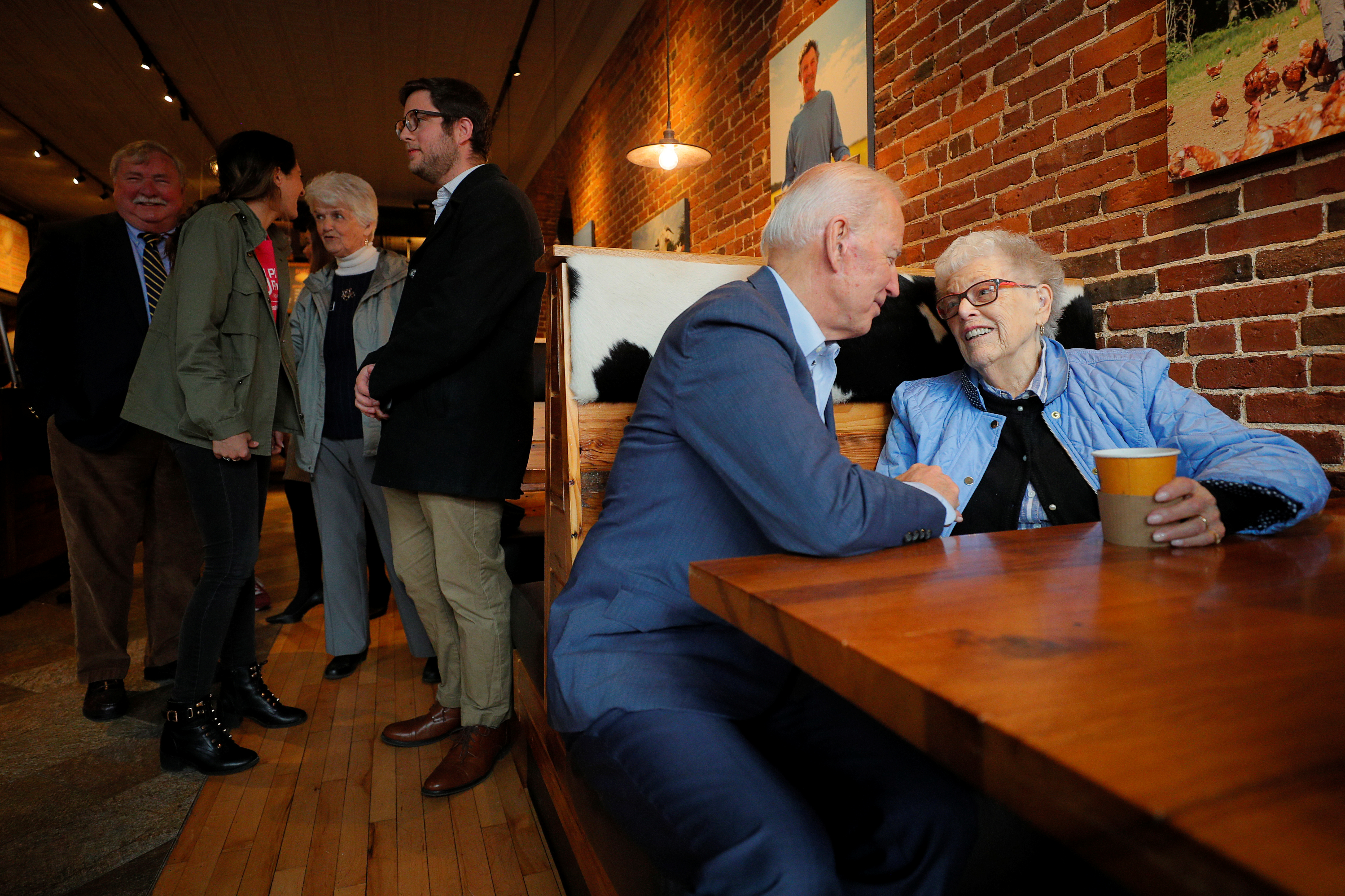 Democratic 2020 U.S. presidential candidate and former Vice President Joe Biden talks to Rita Marion during a campaign stop at The Works in Concord, New Hampshire, U.S., May 14, 2019. REUTERS/Brian Snyder