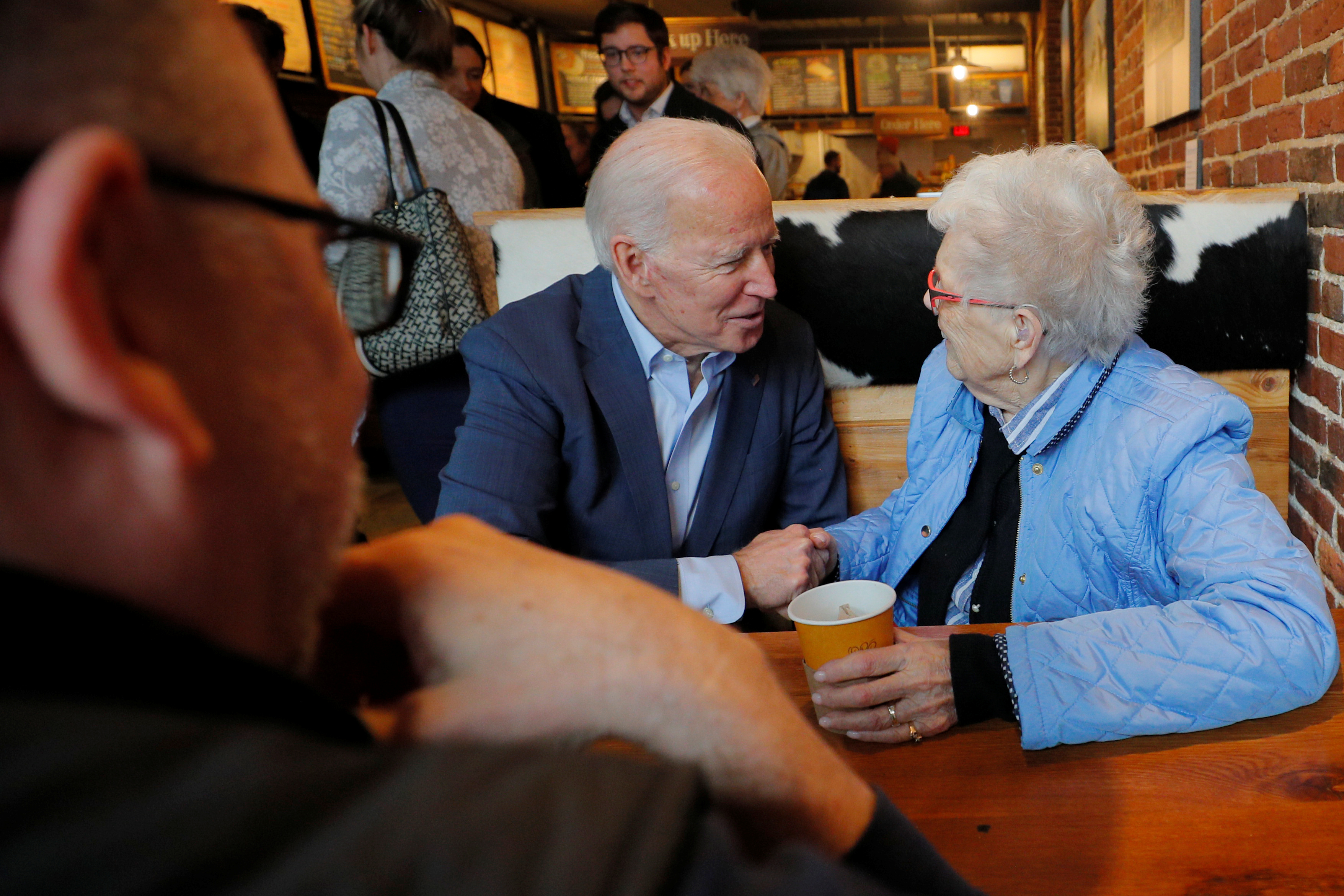 Democratic 2020 U.S. presidential candidate Biden talks to Rita Marion at The Works in Concord