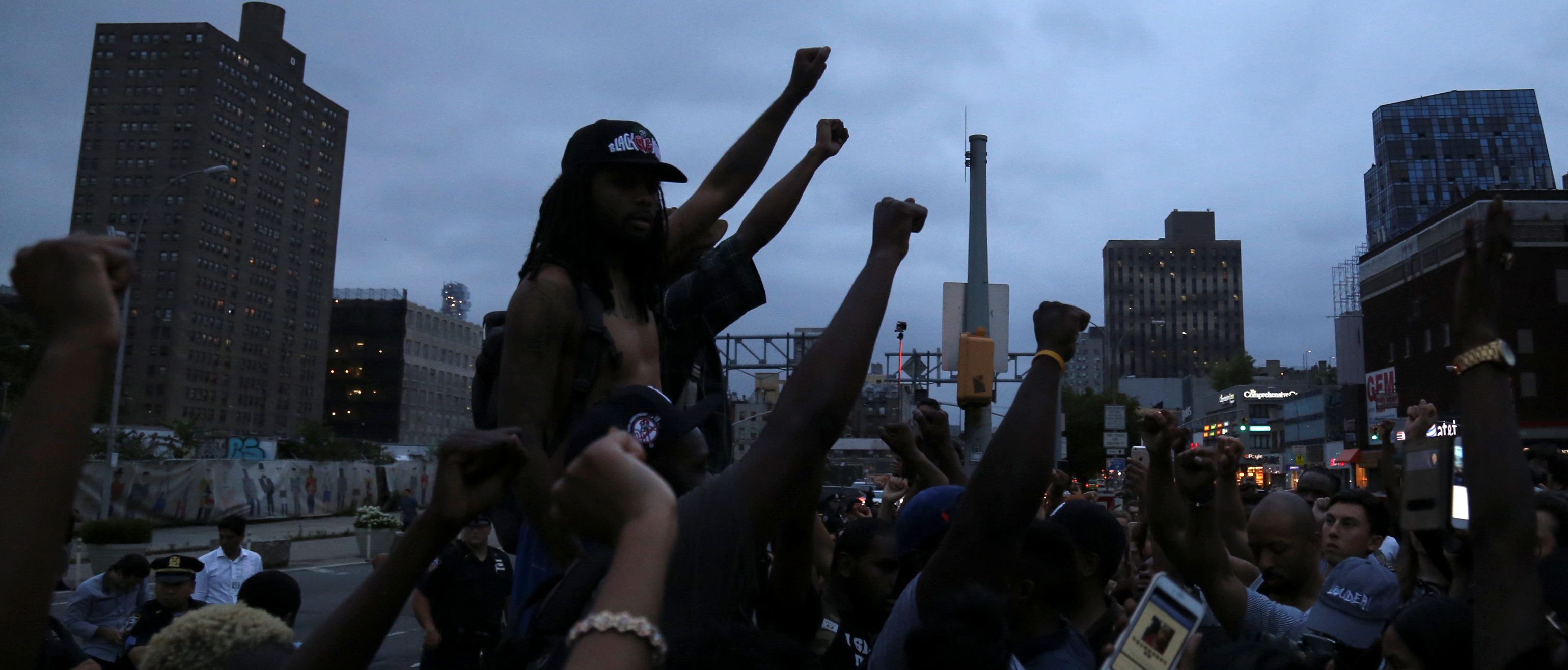 Protesters raise their hands in solidarity as they prepare to march across the Williamsburg Bridge against police brutality in Manhattan, New York, U.S., July 8, 2016. REUTERS/Bria Webb