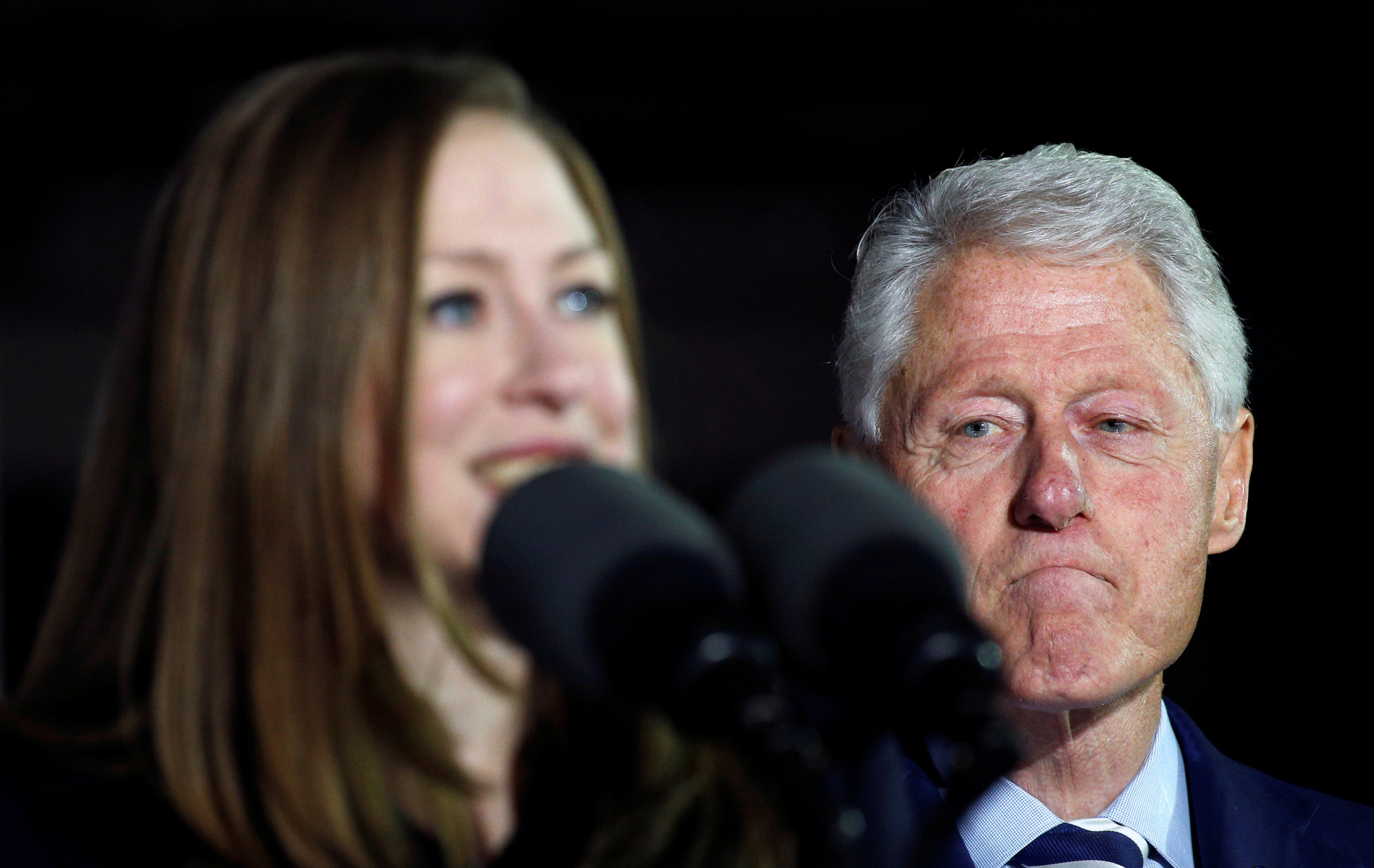 Former President Bill Clinton listens as his daughter Chelsea speaks during a campaign rally for Democratic presidential candidate Hillary Clinton at Independence Hall in Philadelphia, Pennsylvania November 7, 2016. REUTERS/Kevin Lamarque