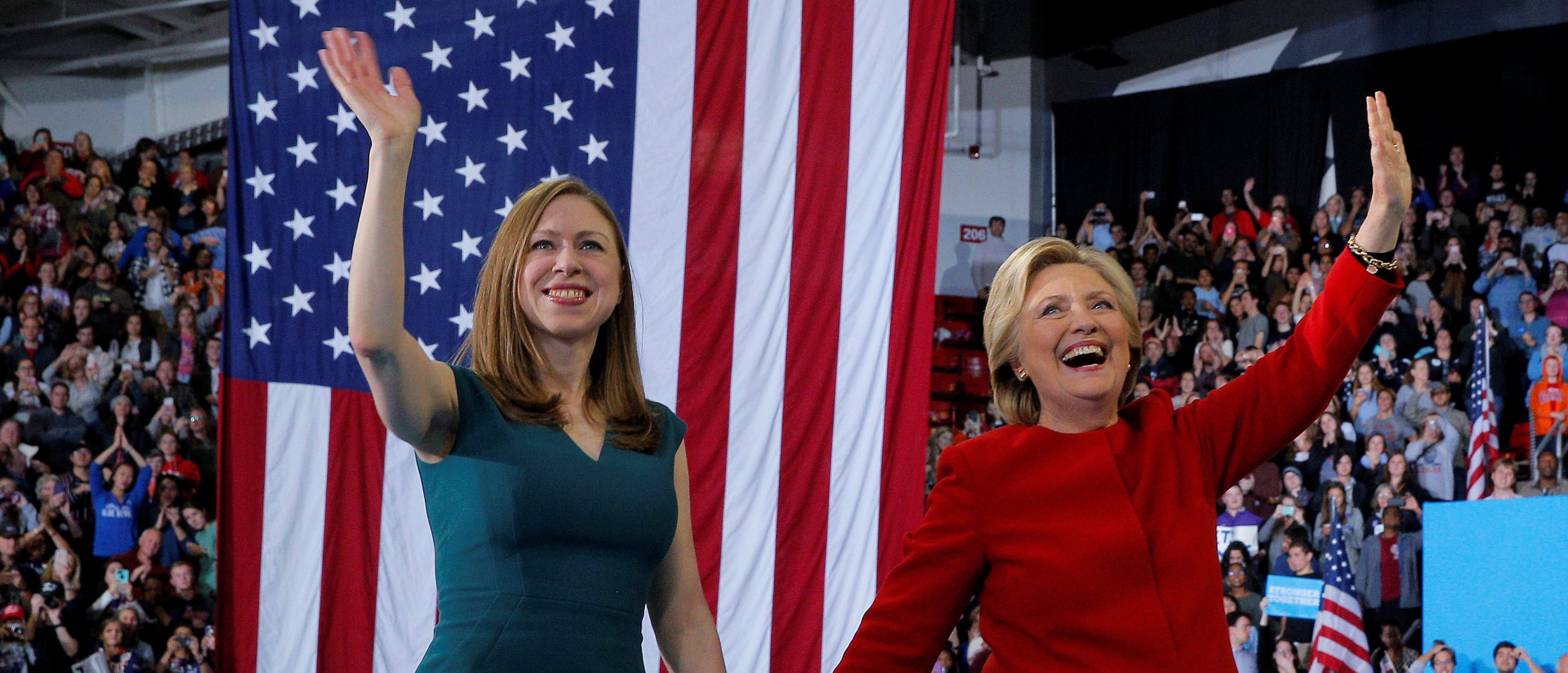 U.S. Democratic presidential nominee Hillary Clinton and her daughter Chelsea wave to the crowd at a campaign rally in Raleigh, North Carolina, U.S. November 8, 2016. (Brian Snyder/Reuters)