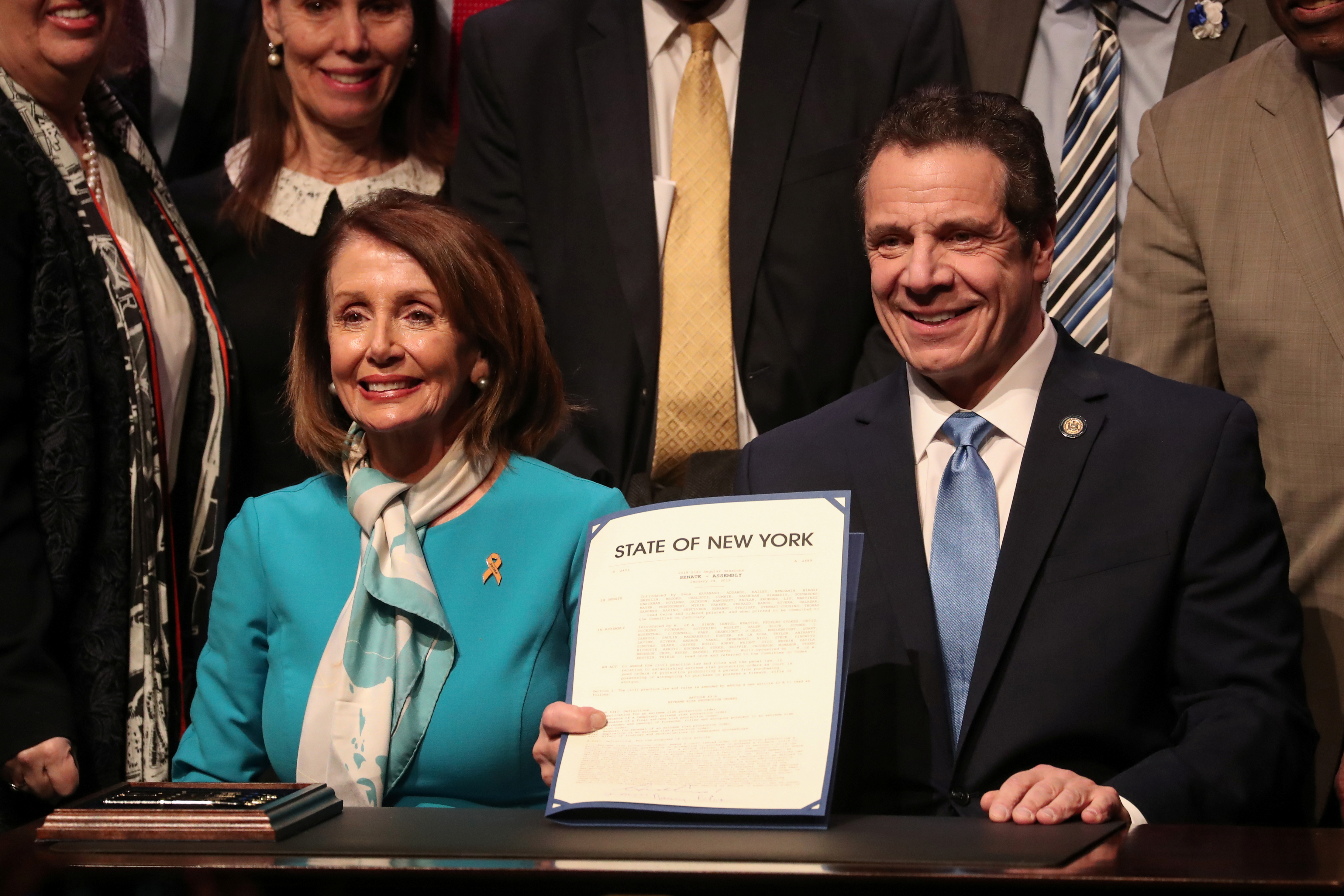 New York Governor Andrew Cuomo and U.S. Speaker of the House Nancy Pelosi (D-CA) smile after signing the Red Flag bill, also known as the Extreme Risk Protection Order bill, in New York