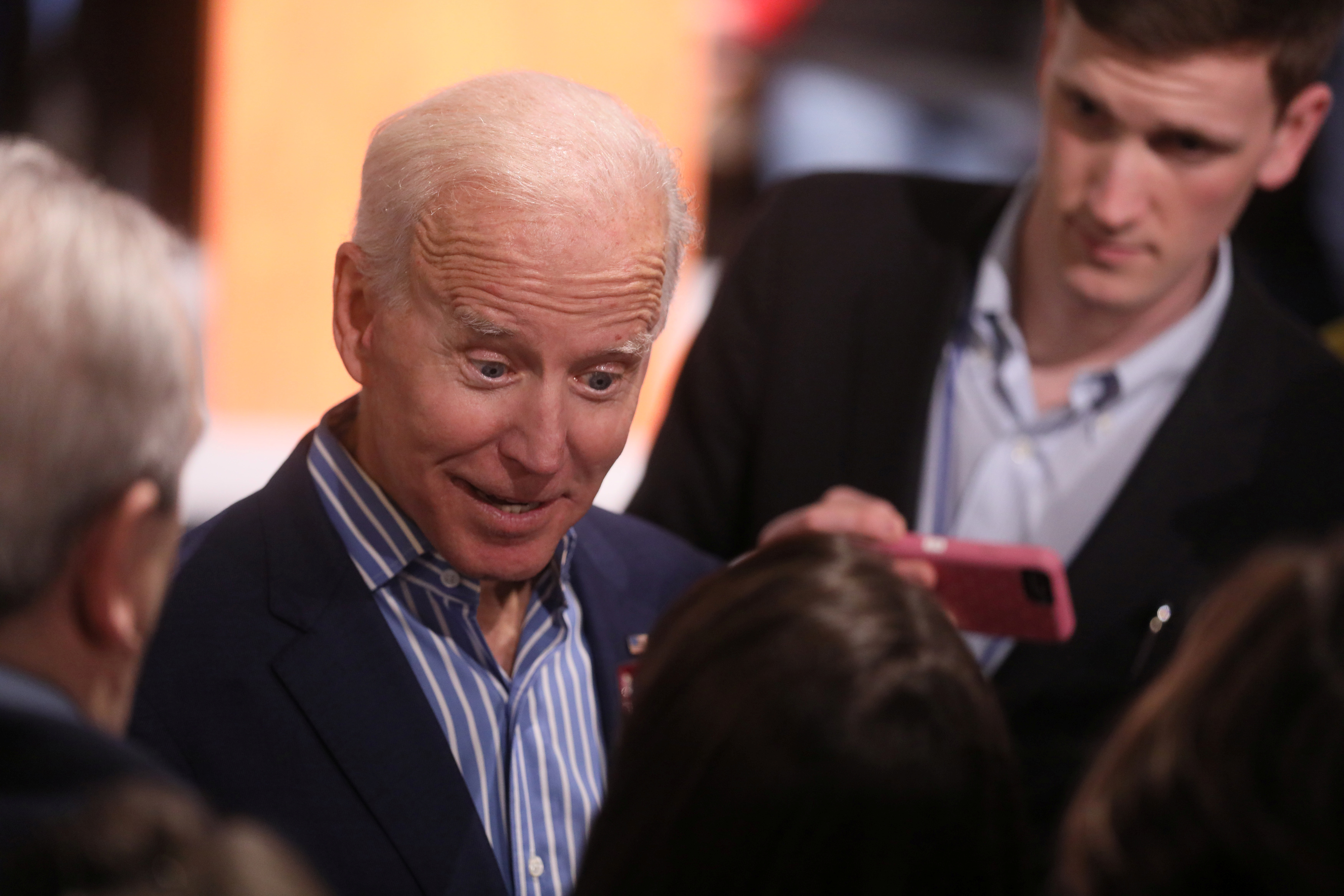 U.S. Democratic presidential candidate Biden greets people in the crowd after a campaign stop in Des Moines, Iowa