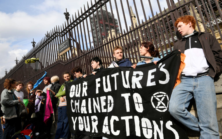 Climate change activists lock themselves at the gate of the Houses of Parliament during an Extinction Rebellion protest in London, Britain, May 3, 2019. REUTERS/Toby Melville.