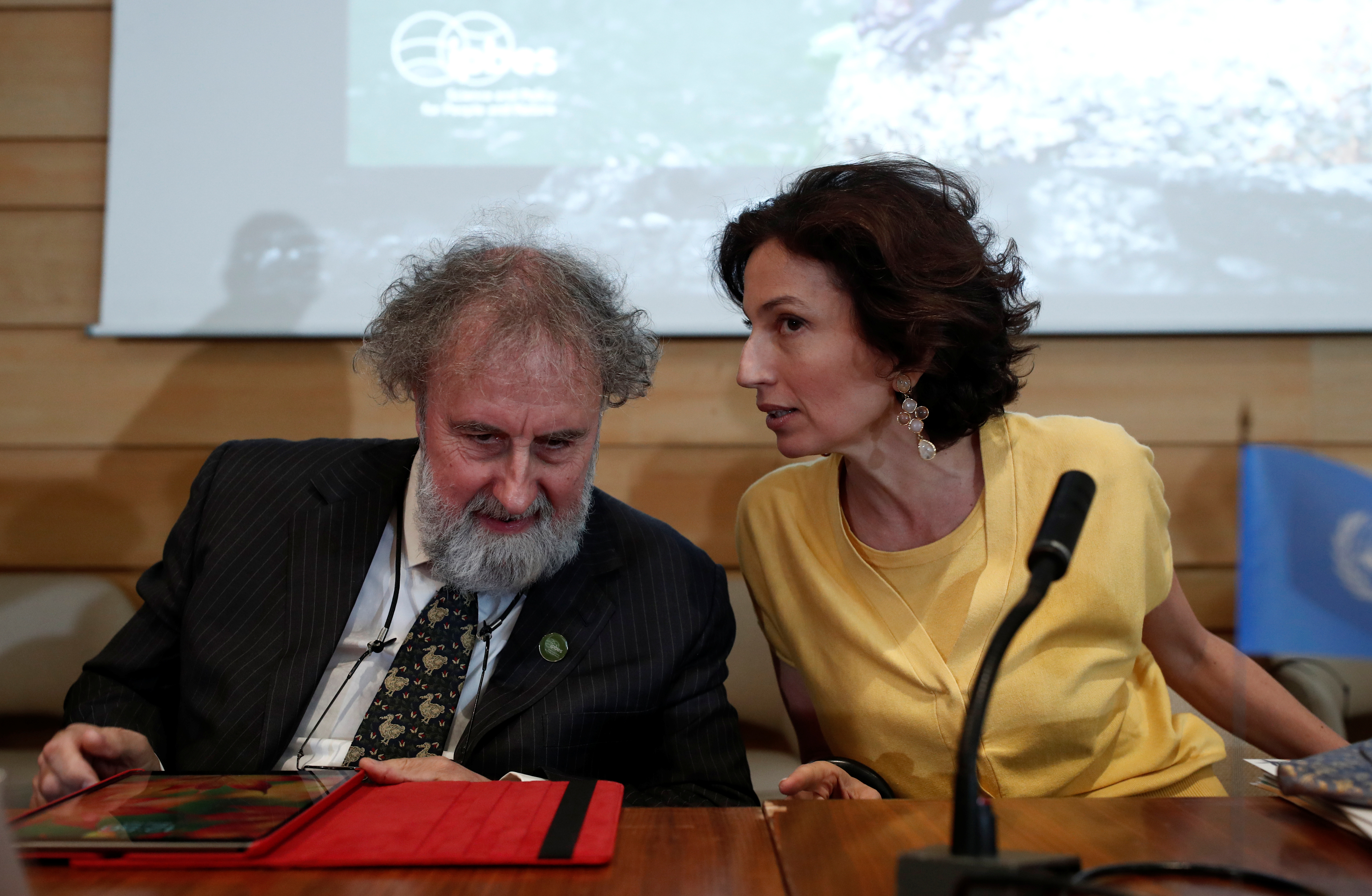 Director-General of UNESCO Azoulay and and former IPBES Chair Robert Watson attend a news conference at the UNESCO headquarters in Paris
