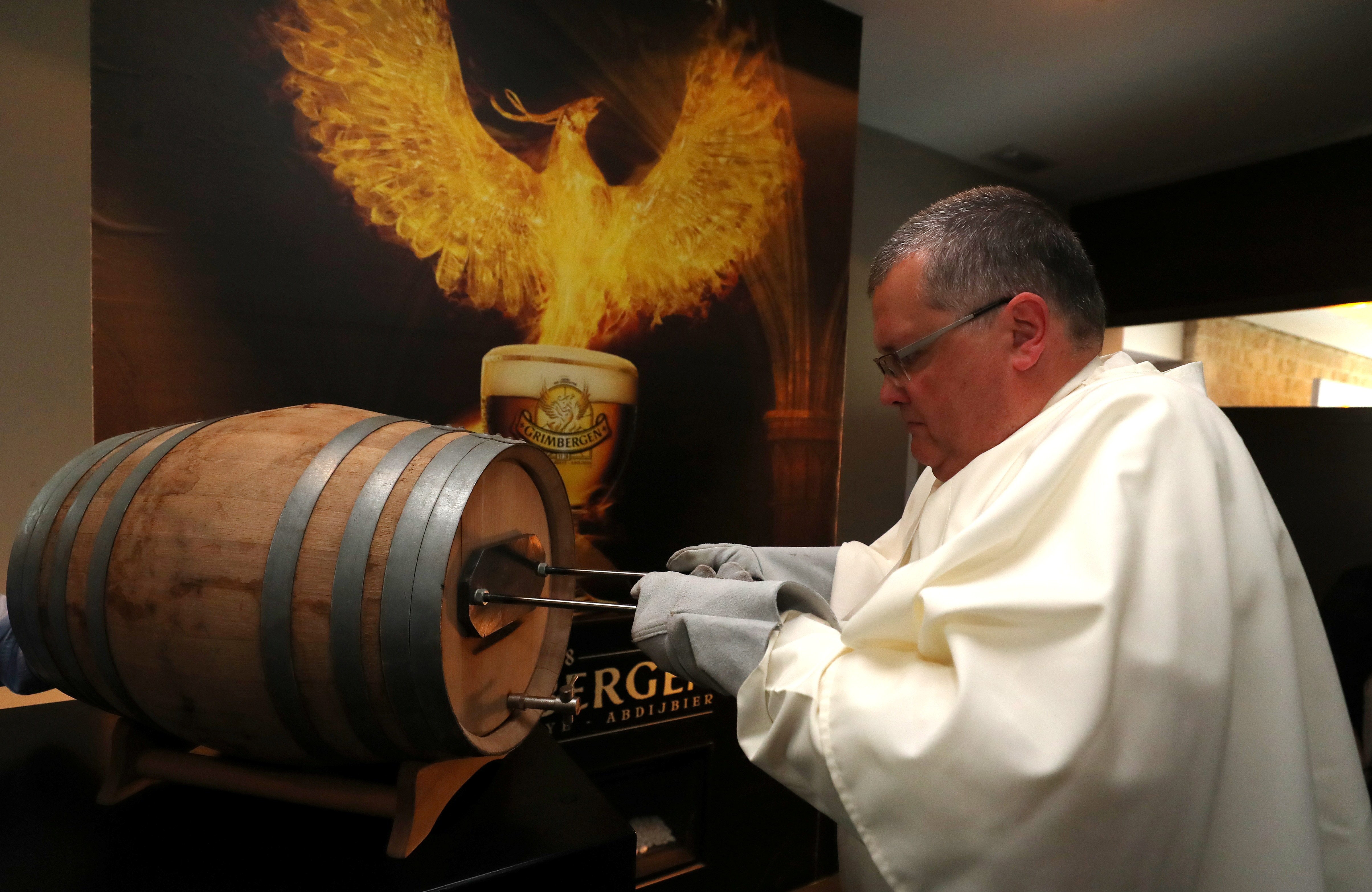 Norbertine Father Karel marks a barrel of Grimbergen beer, symbolised by a phoenix, at the Belgian Abbey of Grimbergen after announcing that the monks will return to brewing after a break of two centuries, in Grimbergen, Belgium May 21, 2019. REUTERS/Yves Herman