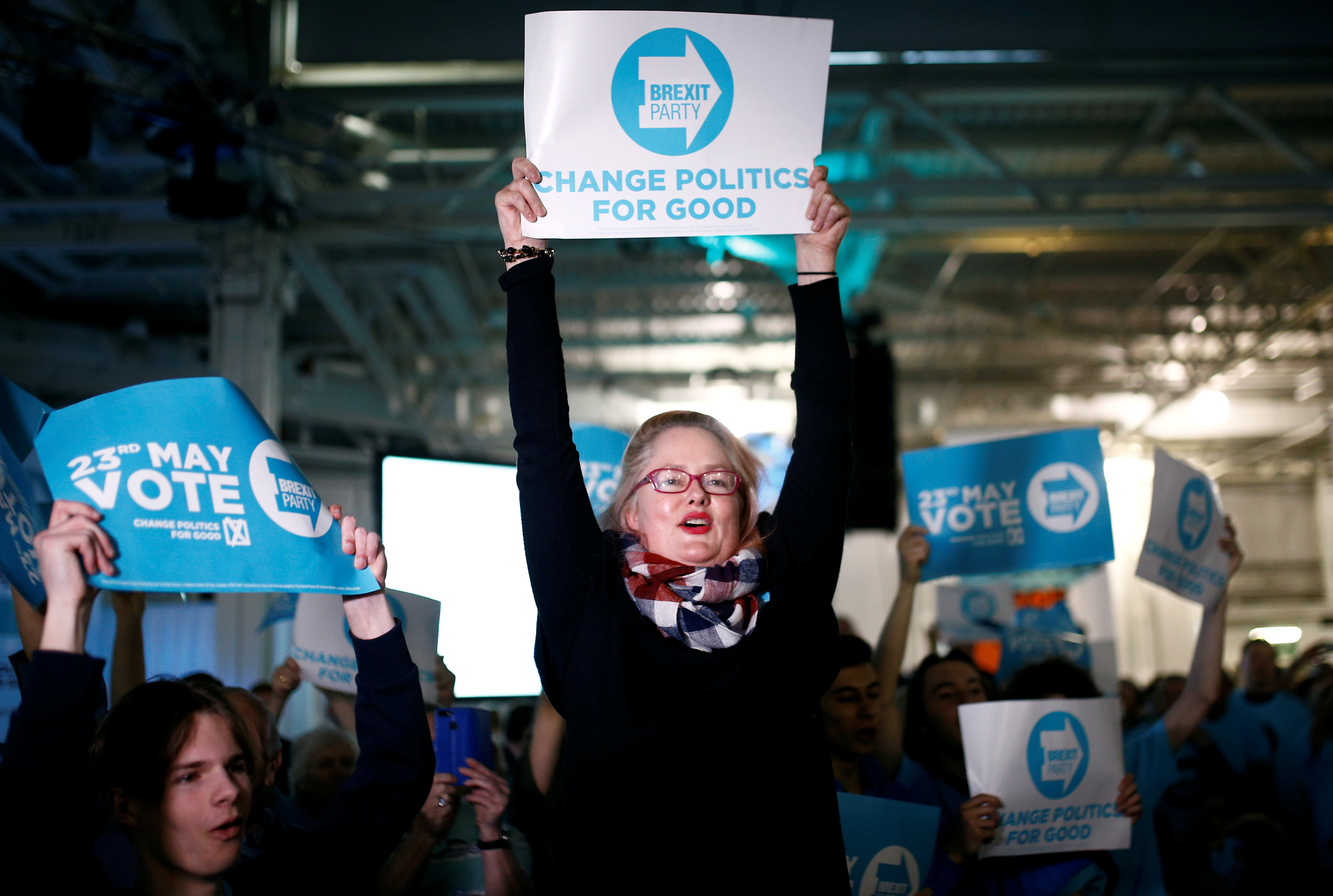A woman holds up a placard at a Brexit Party campaign event in London, Britain, May 21, 2019. REUTERS/Henry Nicholls