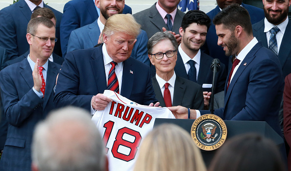 WASHINGTON D.C. - MAY 9: U.S. President Donald Trump is presented with a souvenir Red Sox jersey by Boston Red Sox player J.D. Martinez during a ceremony honoring the 2018 World Series Champions held on the South Lawn of the White House in Washington D.C. on May 9, 2019. (Photo by Jim Davis/The Boston Globe via Getty Images)