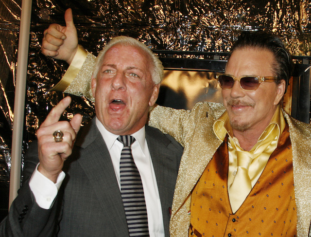 "Actor Mickey Rourke (R), star of the film ""The Wrestler,"" poses with retired professional wrestler Ric Flair at the film's Los Angeles premiere in Beverly Hills, California, December 16, 2008. REUTERS/Fred Prouser"
