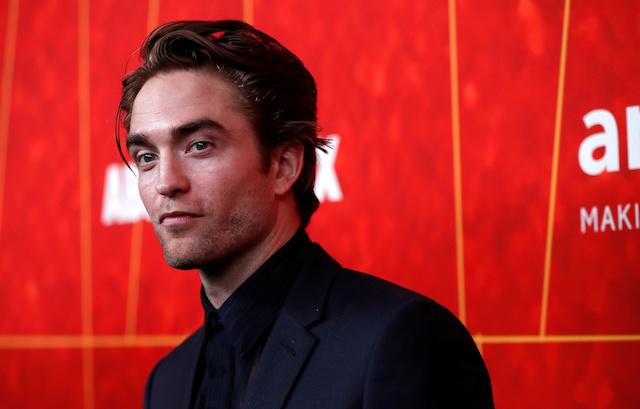Actor Robert Pattinson poses at the ninth amfAR Gala Los Angeles in Beverly Hills, California, U.S., October 18, 2018. REUTERS/Mario Anzuoni
