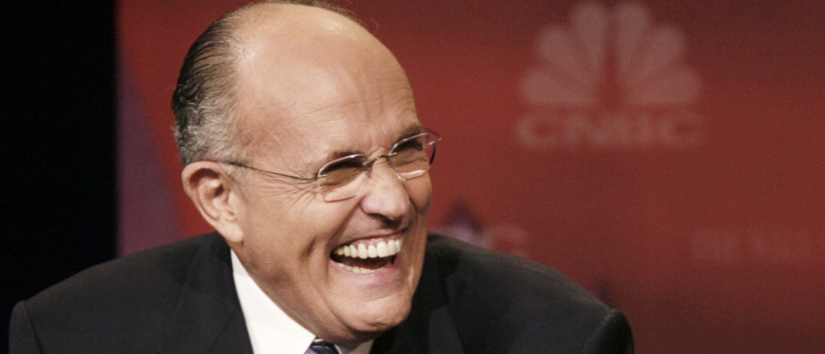 Republican presidential candidate, former New York Mayor Rudy Giuliani, laughs during the Republican presidential debate in Dearborn, Michigan, Oct. 9, 2007. REUTERS/Jason Reed