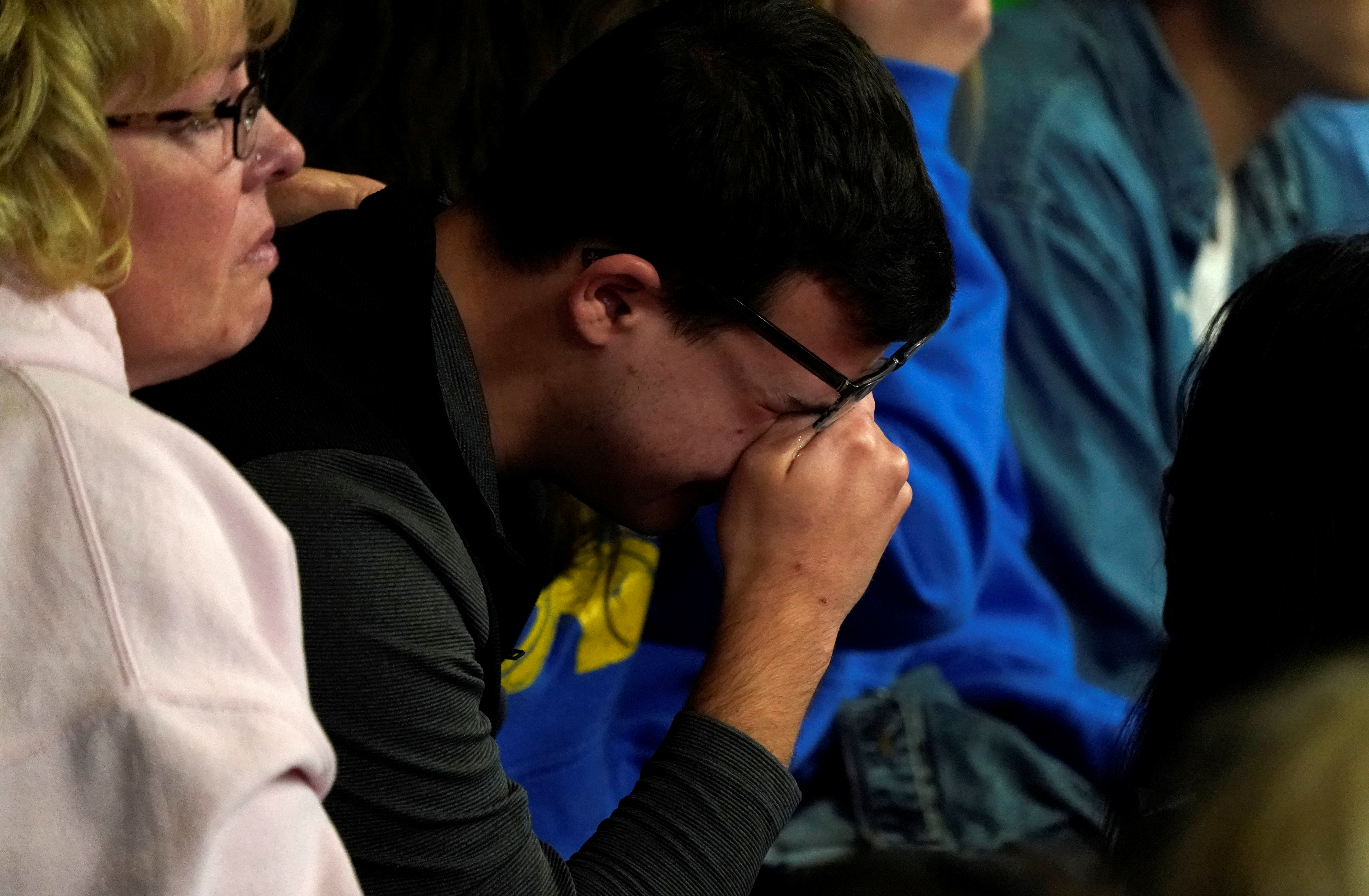 A man cries at a vigil for the victims of the shooting at the Science, Technology, Engineering and Math (STEM) School in Highlands Ranch, Colorado, U.S., May 8, 2019. REUTERS/Rick Wilking