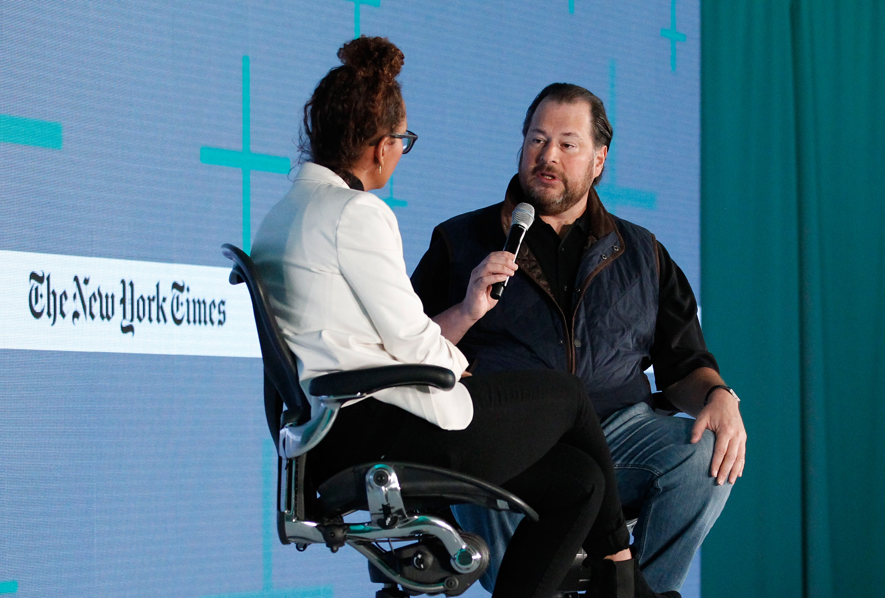 HALF MOON BAY, CA - MARCH 01: Jenna Wortham, The New York Times Magazine Staff Writer (L) and Marc Benioff, Chairman and C.E.O. of Salesforce, speak onstage at The New York Times New Work Summit on March 1, 2016 in Half Moon Bay, California. (Photo by Kimberly White/Getty Images for New York Times)