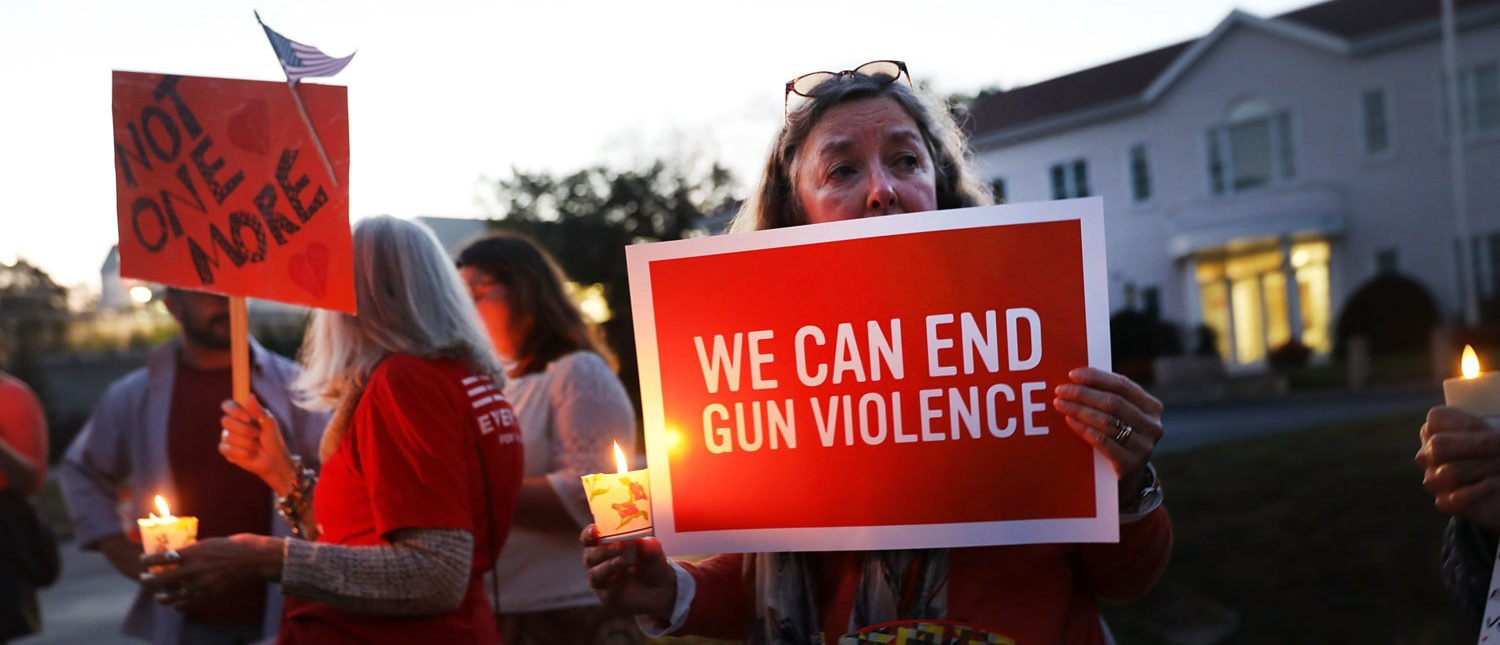 Dozens of people attend a vigil remembering the 59 people killed in Sunday's shooting in Las Vegas and calling for action against guns on October 4, 2017 in Newtown, Connecticut. (Spencer Platt/Getty Images)