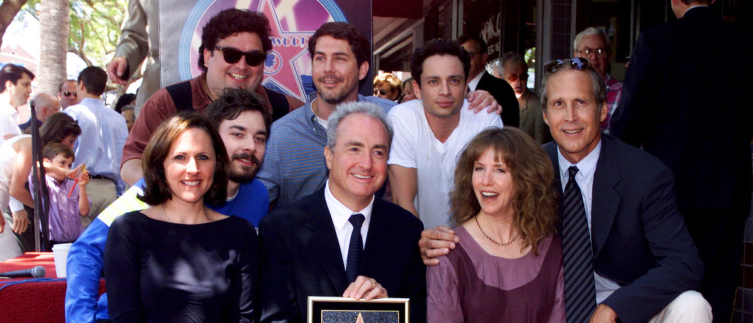 """Television and film producer Lorne Michaels poses with cast members from """"Saturday Night Live"""" after his star on the Hollywood Walk of Fame was unveiled during ceremonies August 19 along Hollywood Boulevard. Shown are (L-R) Molly Shannon, Jimmy Fallon, Horatio Sanz, Chris Parnell, Michaels, Chris Kattan, Laraine Newman and Chevy Chase. Michaels is the creator and executive producer of the late night television program """"Saturday Night Live."""" [Fred Prouser - Reuters]"""