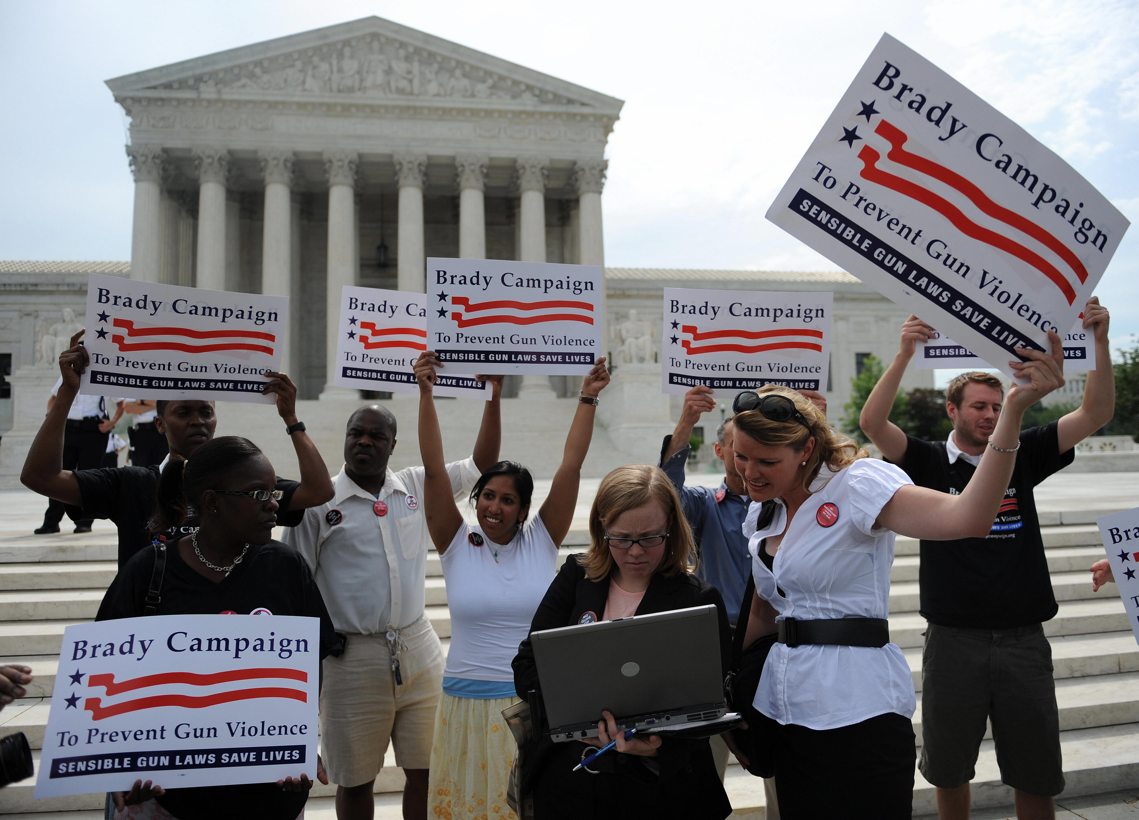 Gun opponents get the news from the Supreme Court ended a ban on owning handguns in Washington, D.C. on June 26, 2008. (Tim Sloan/AFP/Getty Images)