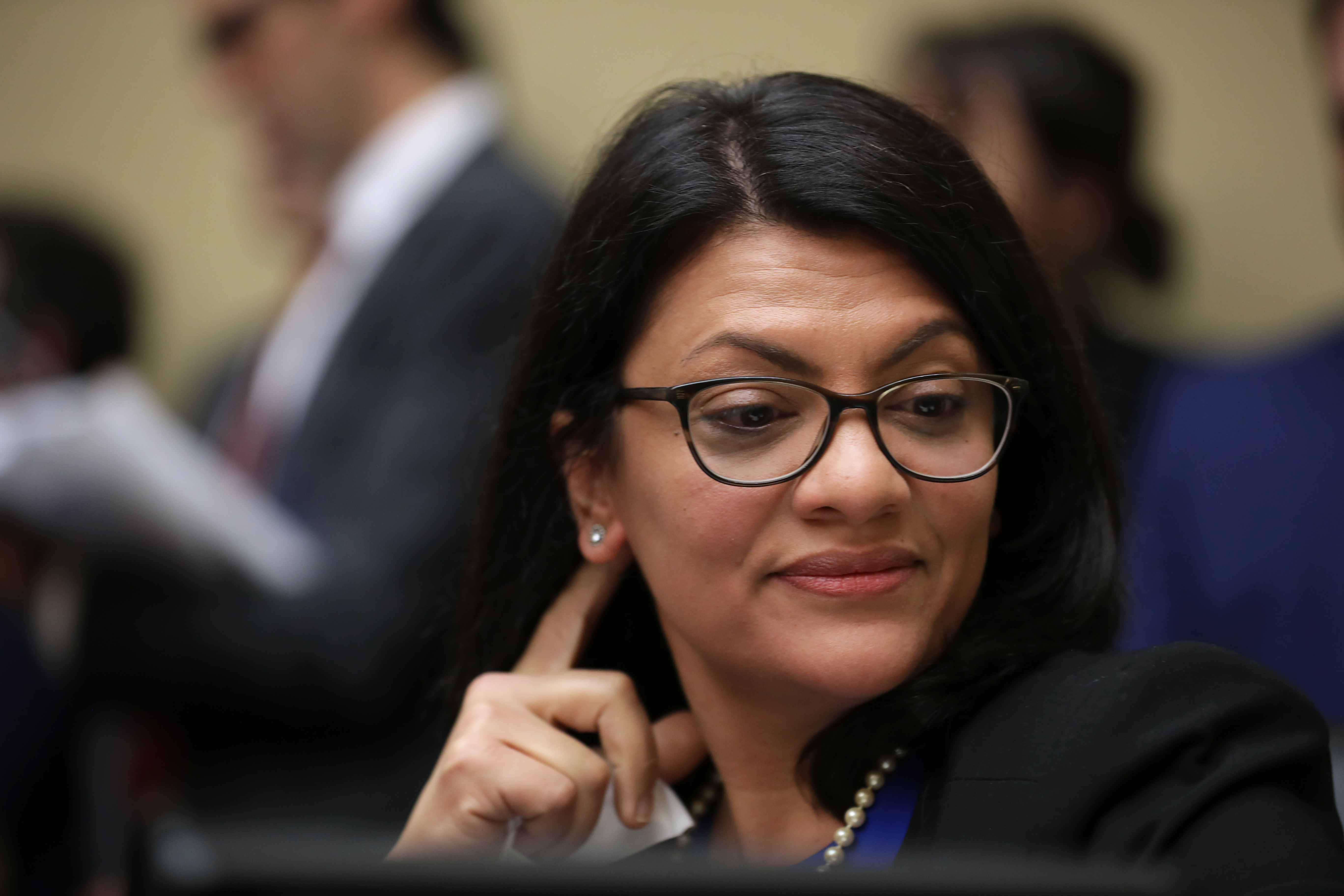 Rep. Rashida Tlaib (D-MI) listens to Michael Cohen testify before the House Oversight Committee. (Chip Somodevilla/Getty Images)