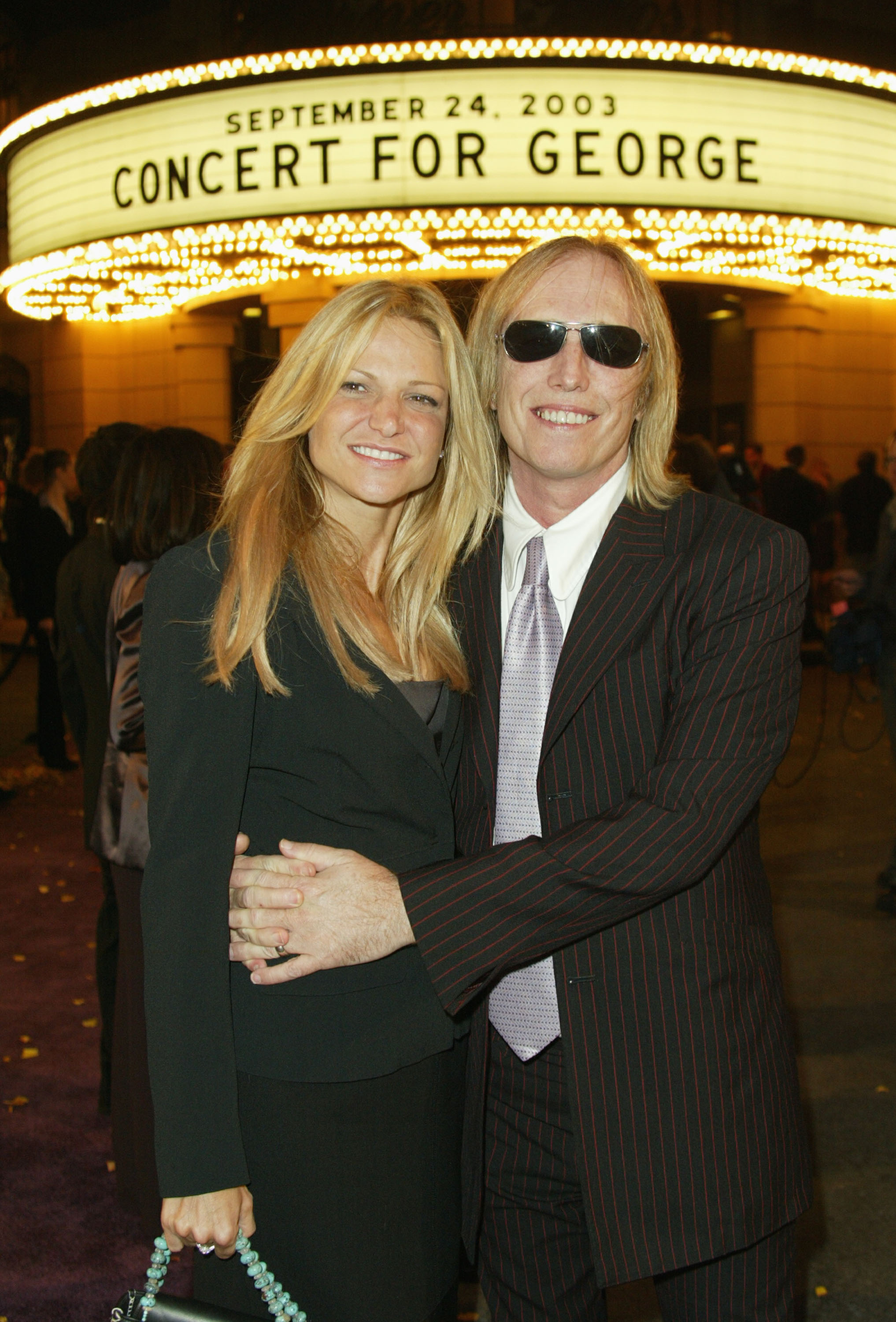 """Musician Tom Petty and his wife Dana York arrive for a special screening at the Steven J. Ross Theater at Warner Bros. Studios of the film ''Concert for George"""" September 24, 2003 in Burbank, California. The documentary celebrates the music of former Beatle George Harrison through performances by legendary musicians. (Photo by Frazer Harrison/Getty Images)"""