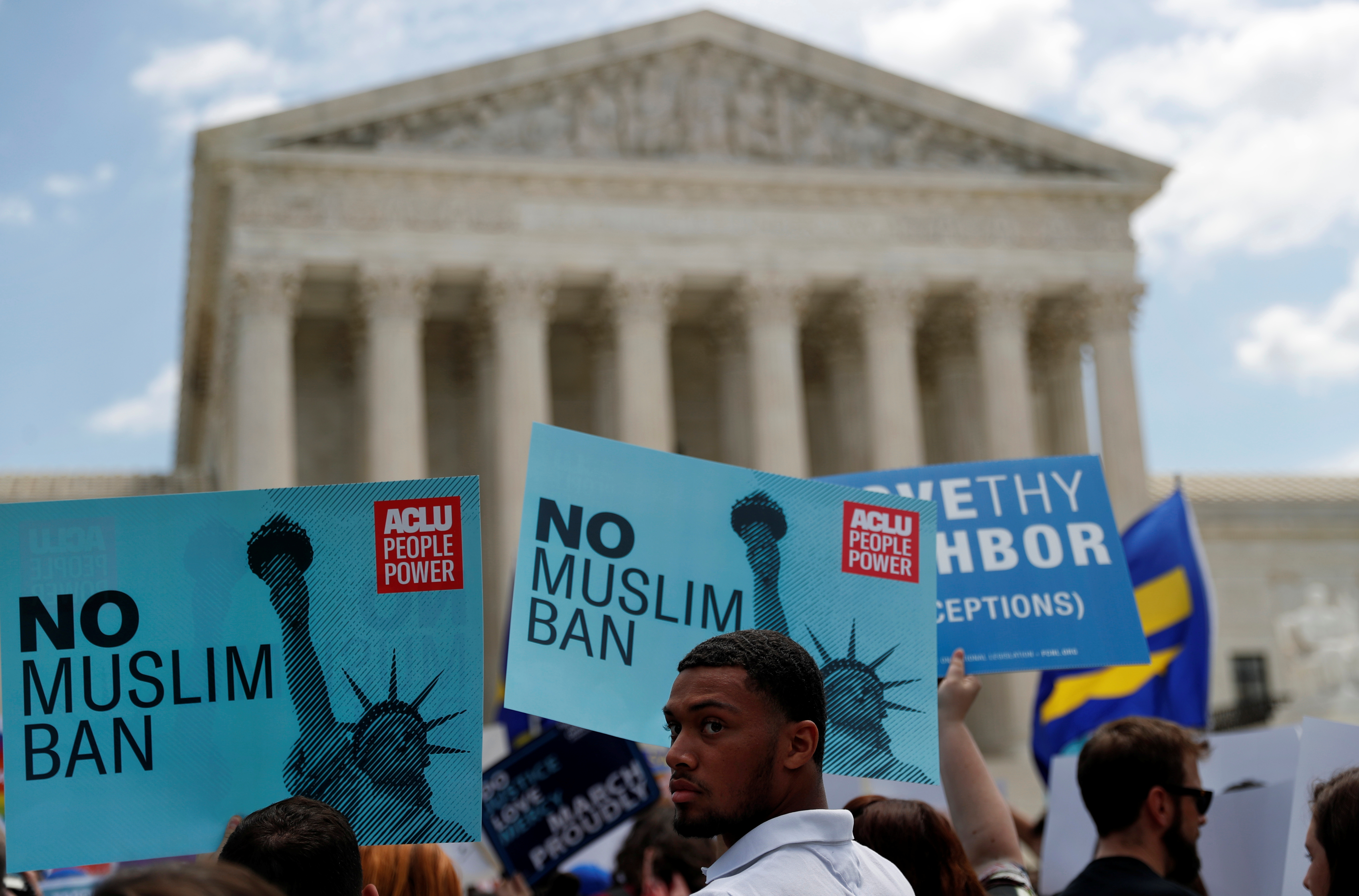 Demonstrators picket the Supreme Court after the justices upheld President Trump's travel ban on June 26, 2018. REUTERS/Leah Millis
