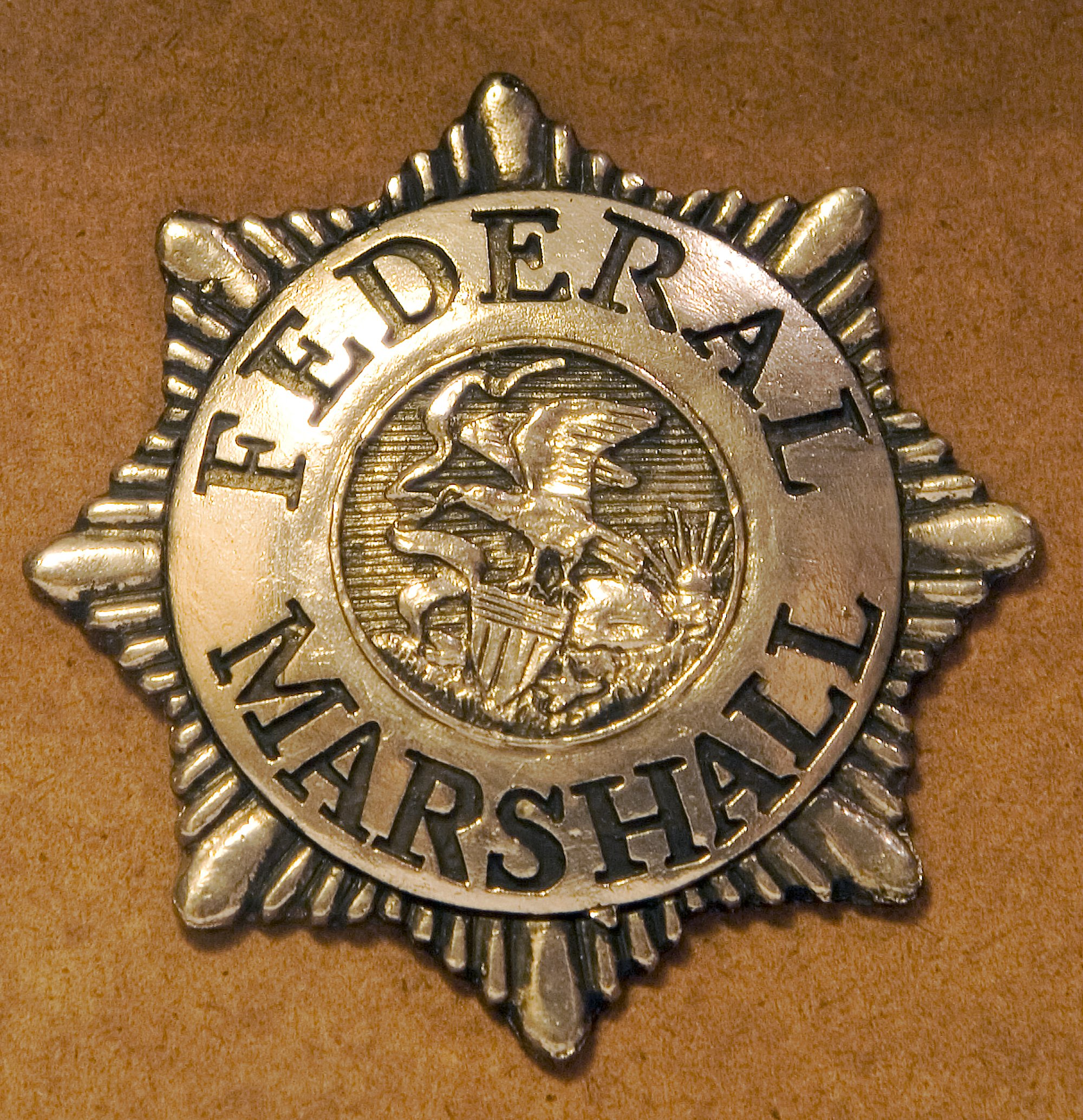 Pictured is a U.S. Marshal badge. SHUTTERSTOCK/ Steve Adamson