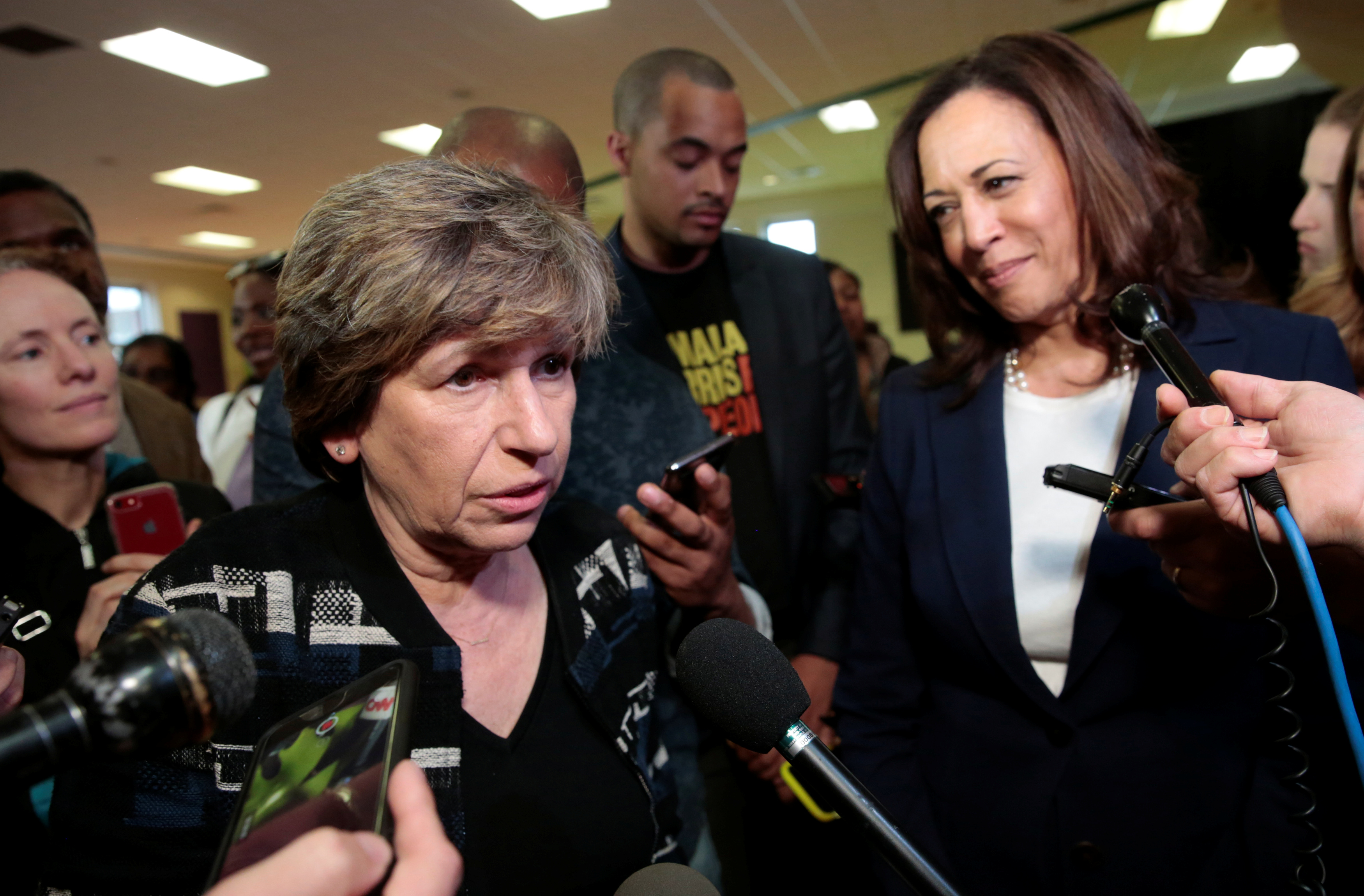 U.S. Senator Kamala Harris (R) listens to American Federation of Teachers president Randi Weingarten speak to the media after speaking to members of the AFT in Detroit, Michigan, U.S. May 6, 2019. REUTERS/Rebecca Cook