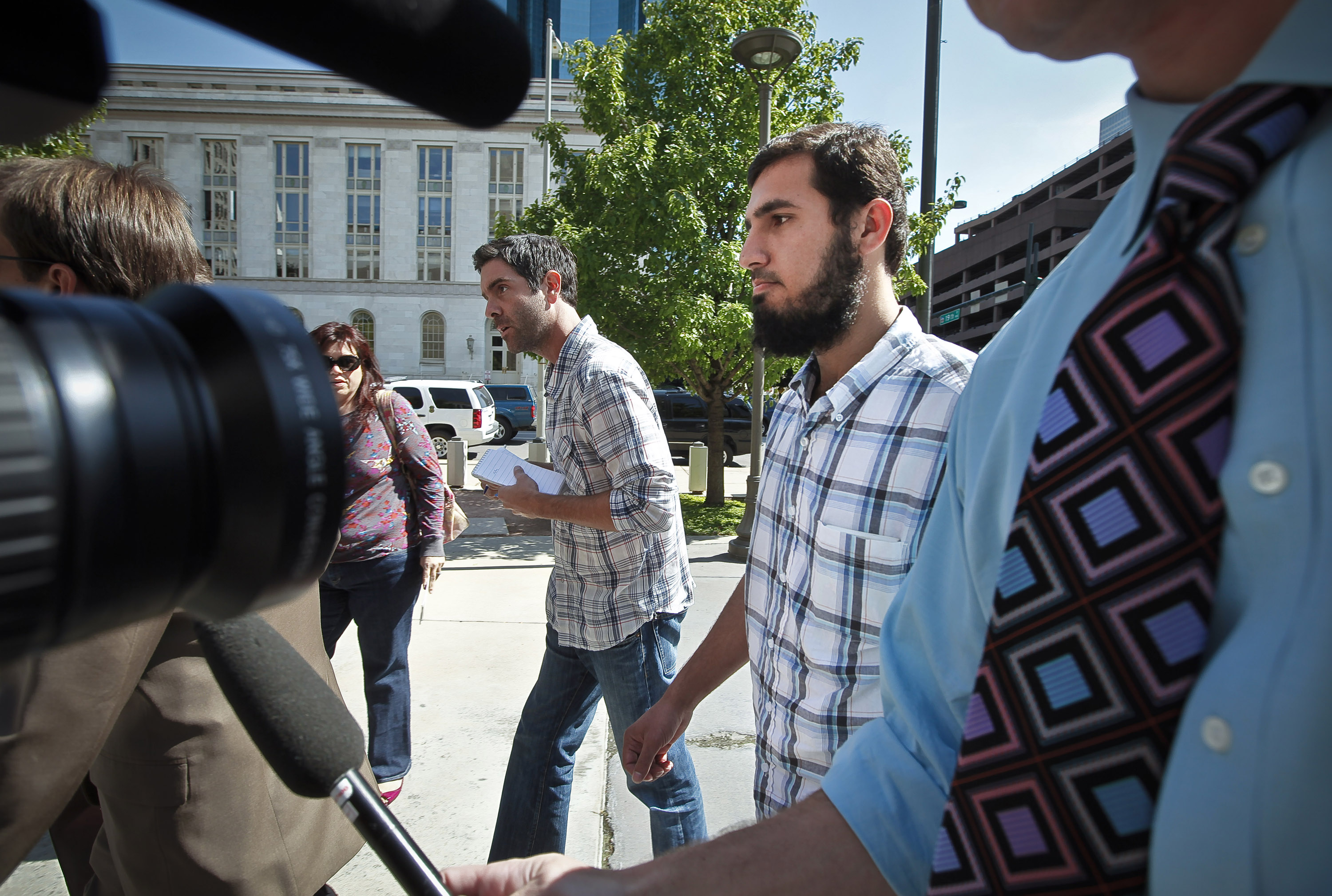 DENVER, COLORADO - SEPTEMEBER 17: Najibullah Zazi (R), 24, arrives at the Byron G. Rogers Federal Building in downtown with his attorney Art Folsom (not pictured) September 17, 2009 in Denver, Colorado. Zazi has been undergoing questioning at the FBI's Denver branch for suspected involvement in a terrorism plot involving peroxide-based explosives. Federal and local authorities searched Zazi's apartment and the home of relatives close by yesterday but have not commented on whether anything was found during the searches. Zazi has repeatedly denied being involved with terrorism or bomb making. Getty Images/ Marc Piscotty