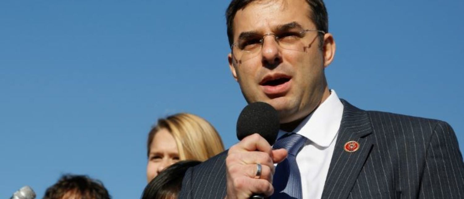 "U.S. Representative Justin Amash (R-MI) addresses the ""Stop Watching Us: A Rally Against Mass Surveillance"" near the U.S. Capitol in Washington, October 26, 2013. REUTERS/Jonathan Ernst"