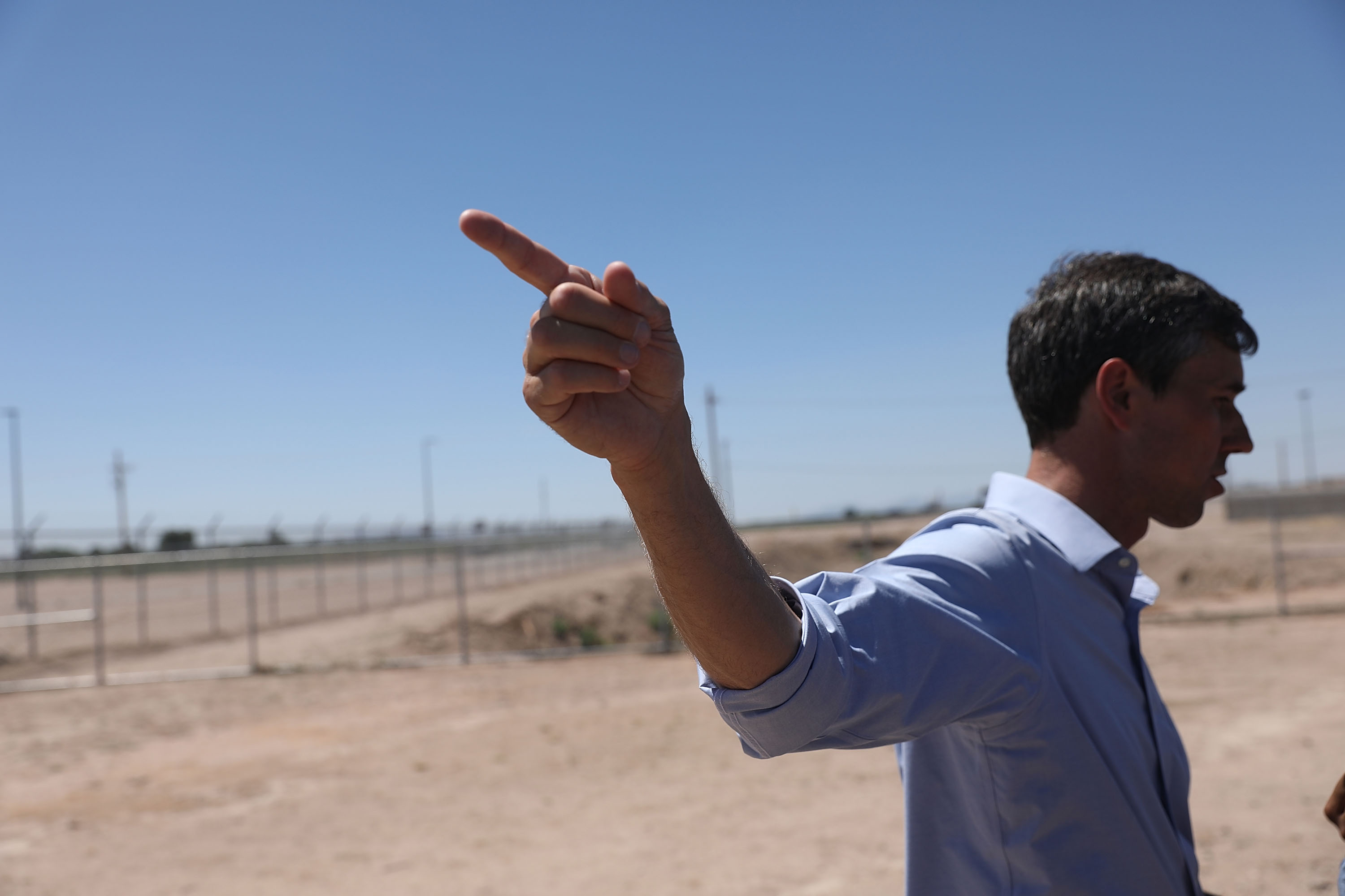 Rep. Beto O'Rourke points toward the tent encampment he toured near the Tornillo-Guadalupe Port of Entry on June 23, 2018. (Joe Raedle/Getty Images)