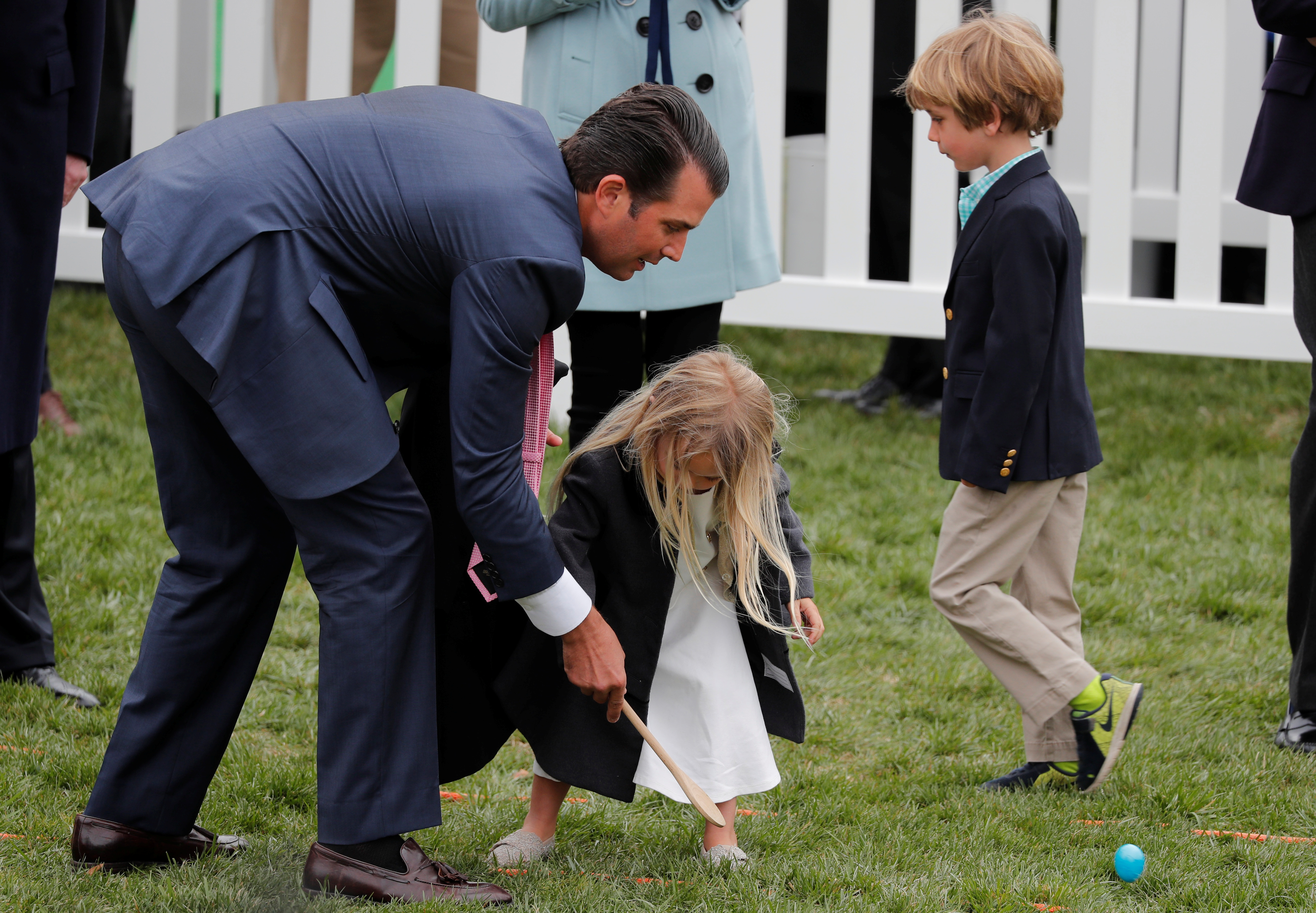 Donald Trump Jr helps his daughter Chloe roll an egg during the annual White House Easter Egg Roll on the South Lawn of the White House in Washington, U.S., April 2, 2018. REUTERS/Carlos Barria