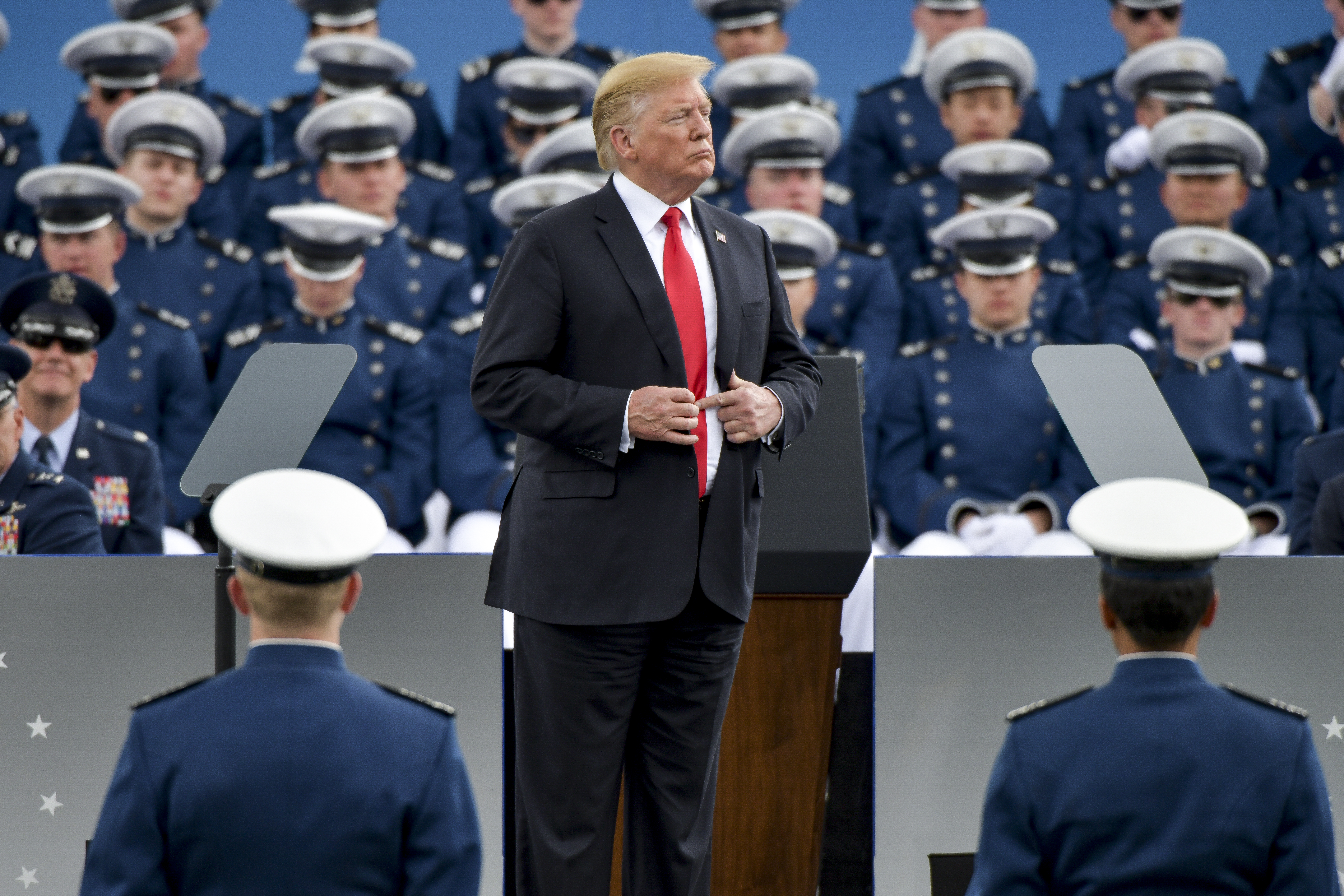 President Donald Trump waits to shake hands with United States Air Force Academy cadets as they receive their diplomas during their graduation ceremony at Falcon Stadium on May 30, 2019 in Colorado Springs, Colorado. (Photo by Michael Ciaglo/Getty Images)
