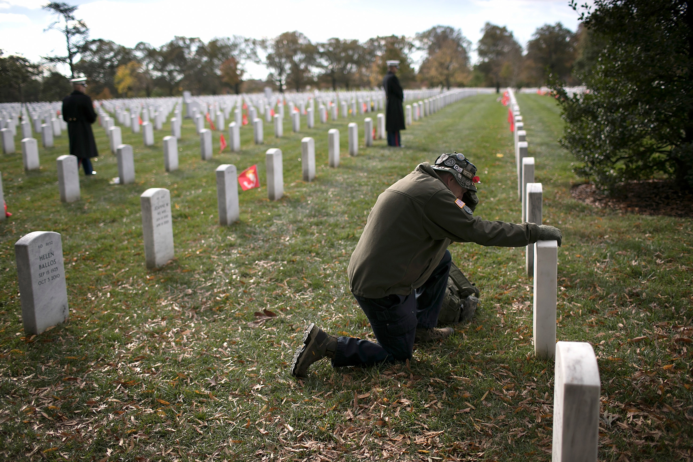 Gulf War veteran John Schoon visits the gravesite of U.S.M.C. Sgt Christopher Hrbek one day before Veterans Day at Arlington National Cemetery November 10, 2017 in Arlington, Virginia. Veterans Day, observed on November 11, honors all members of the U.S. military who served in the United States Armed Forces. Win McNamee/Getty Images