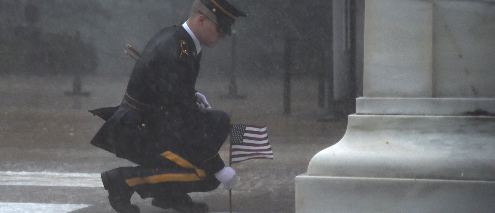 Member of the U.S. Army Old Guard places a flag before the Tomb of the Unknowns. Photo courtesy of the U.S. Army