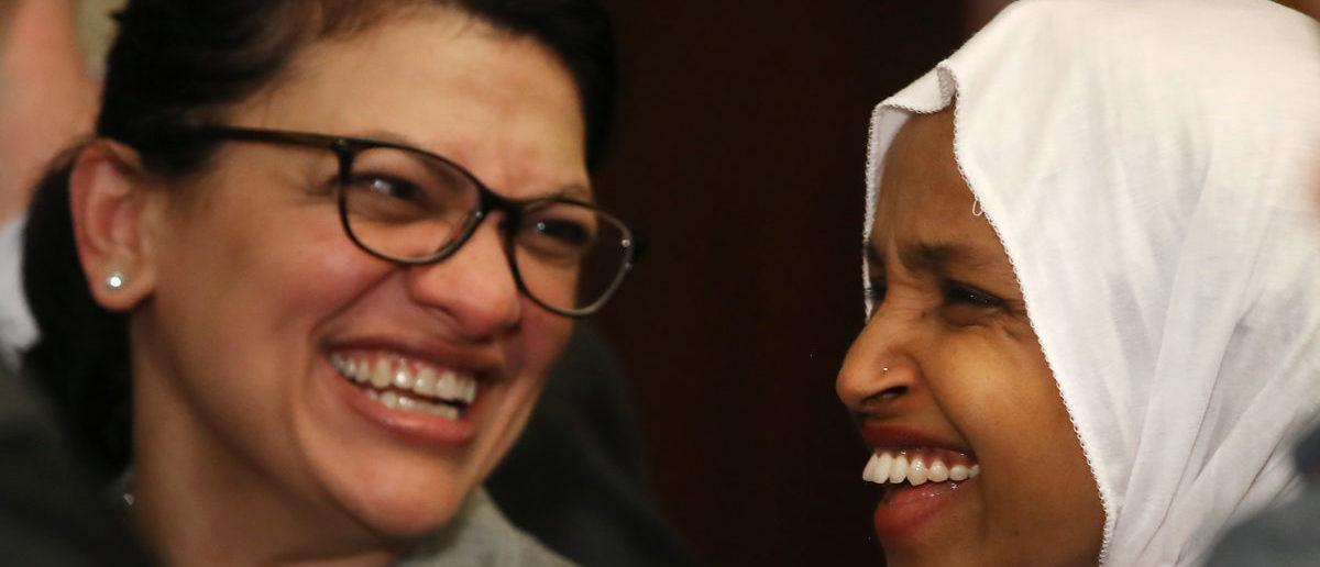 Rep. Ilhan Omar (D-MN) (R) and Rep. Rashida Tlaib (D-MN) (Mark Wilson/Getty Images)