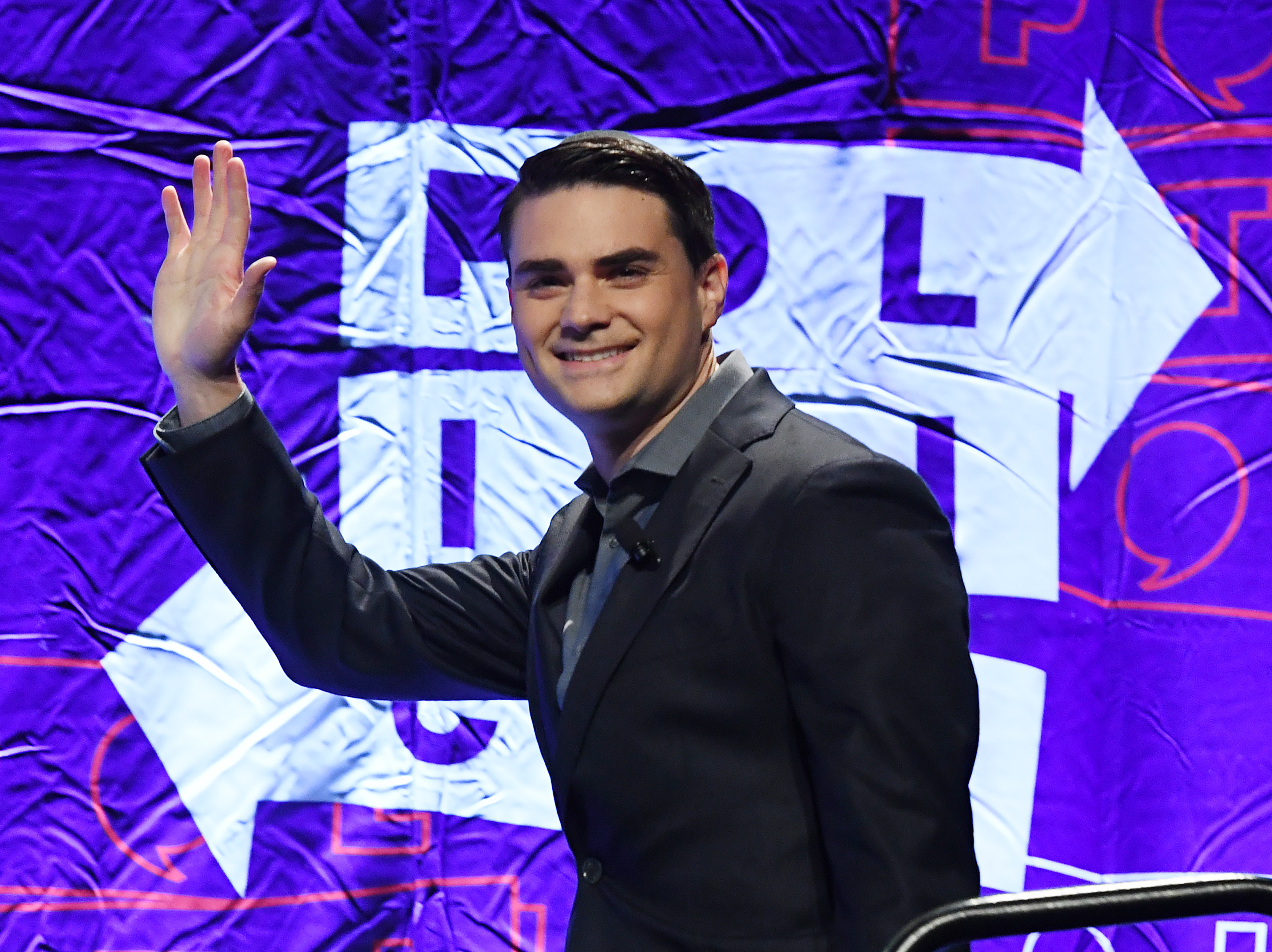 Conservative political commentator, writer and lawyer Ben Shapiro waves to the crowd as he arrives to speak at the 2018 Politicon in Los Angeles, California on October 21, 2018. (Mark Ralston/AFP/Getty Images)