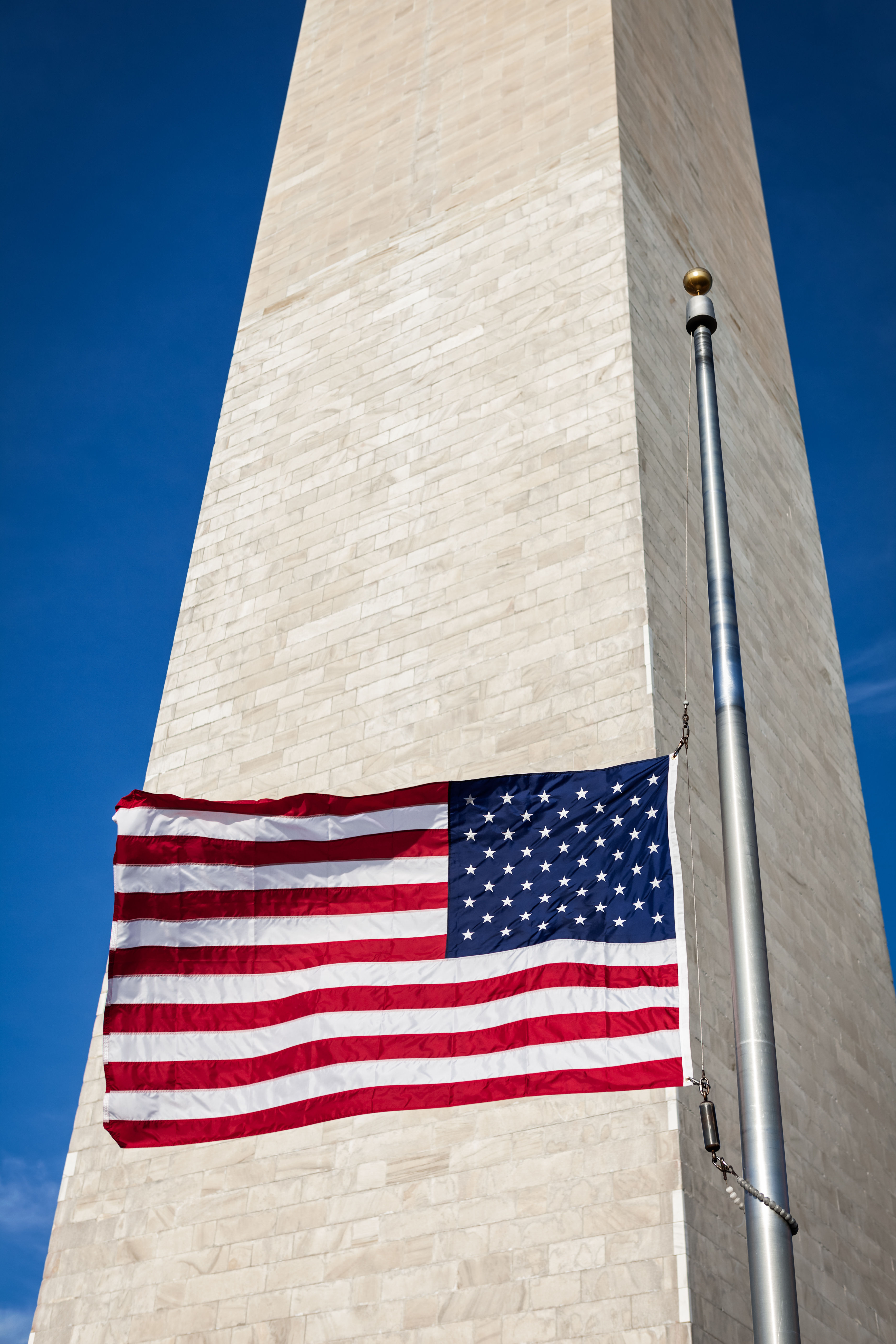 United States Flag flying at half-staff in front of the Washington Monument (eurobanks/Shutterstock)