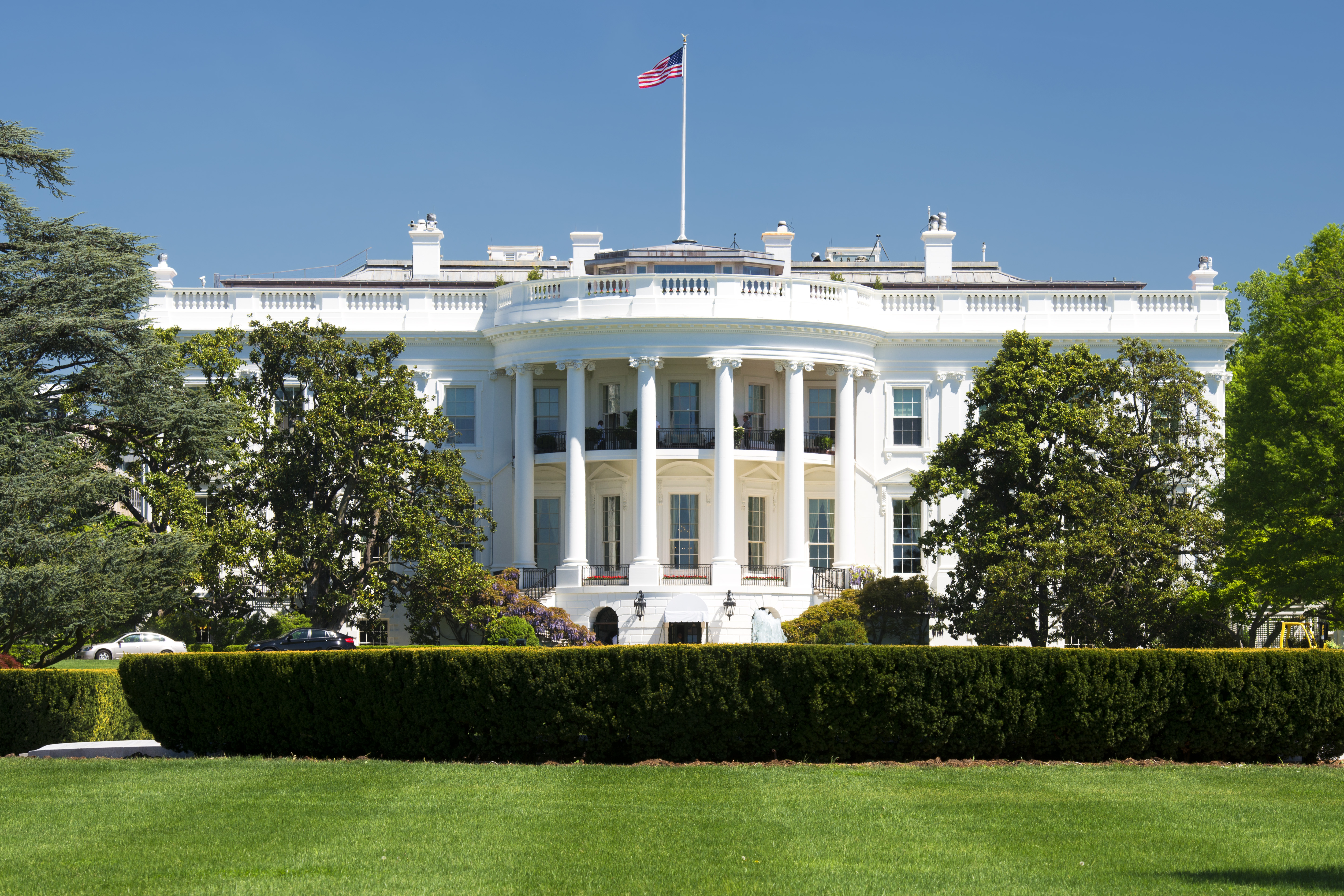 The White House is framed by a deep blue sky. Shutterstock image via Andrea Izzotti