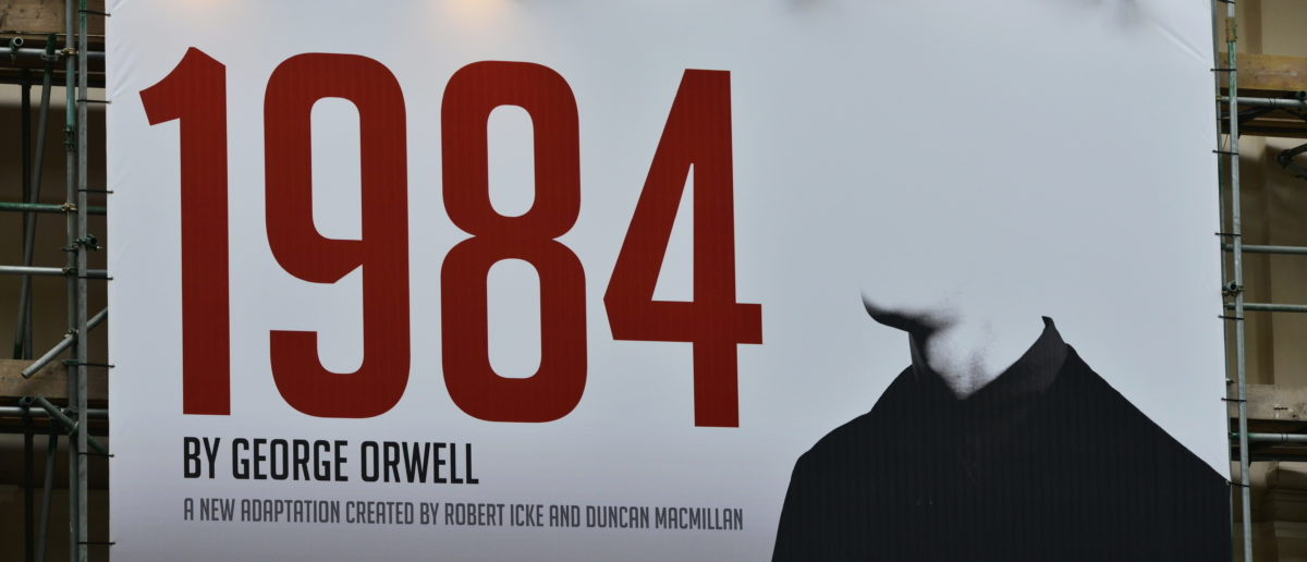 View a billboard advertising Robert Icek and Ducan MacMillan's theatrical adaptation of George Orwell's Nineteen Eighty-Four on May 30, 2015 in London, UK. Source: 1000 Words/Shutterstock