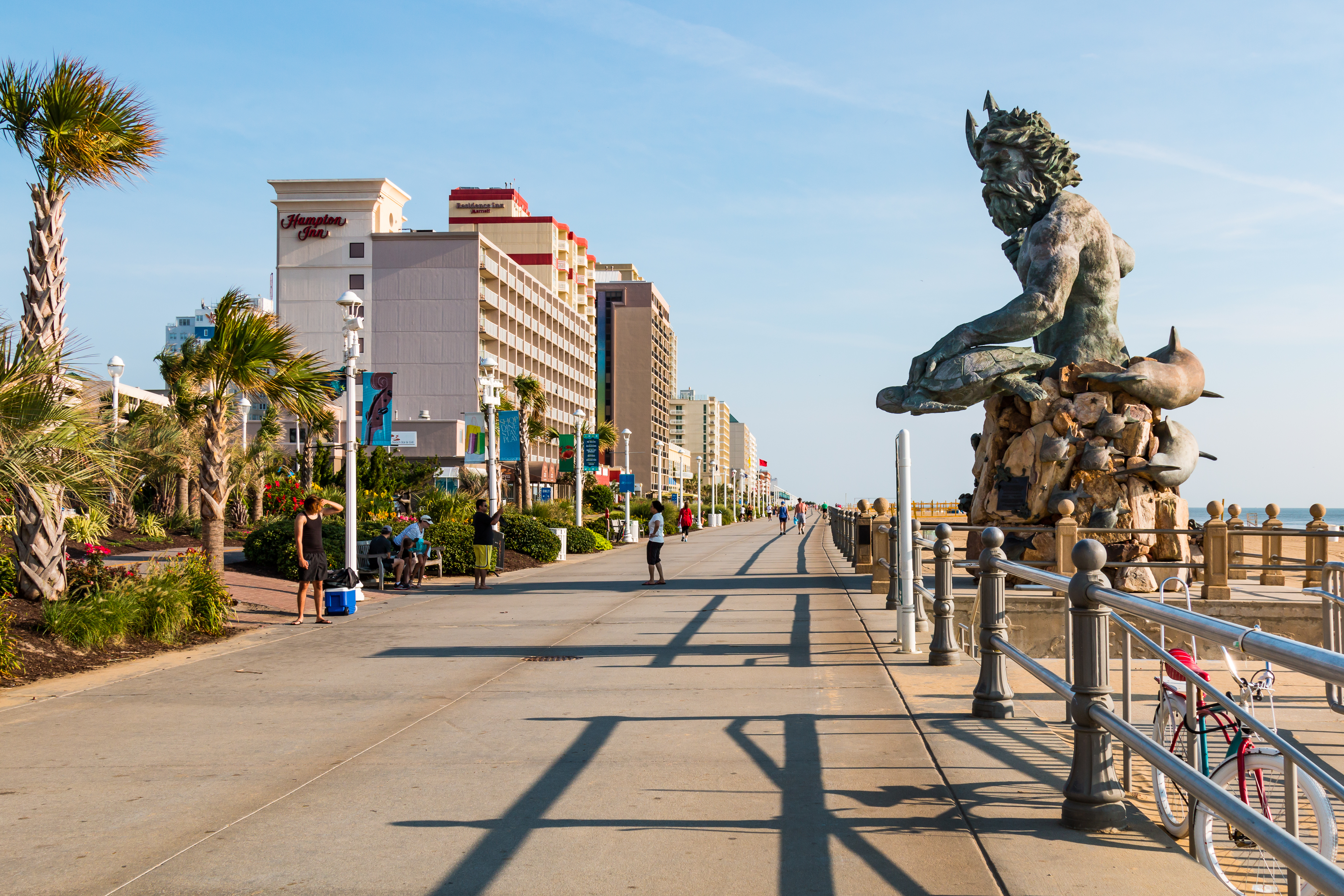 The King Neptune statue by sculptor Paul DiPasquale along the 3-mile long oceanfront boardwalk lined with high-rise hotels on July 13, 2017. Shutterstock image via Sherry V Smith