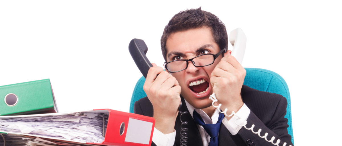 A businessman is upset. Shutterstock image via Elnur