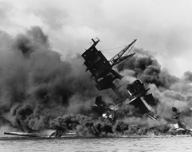 The forward superstructure of the sunken battleship USS Arizona burns after the Japanese raid on Pearl Harbor, December 7, 1941. The 75th anniversary of the attack, which brought the United States into World War Two, is marked on December 7, 2016 U.S. Navy/U.S. Naval History and Heritage Command/Handout via Reuters