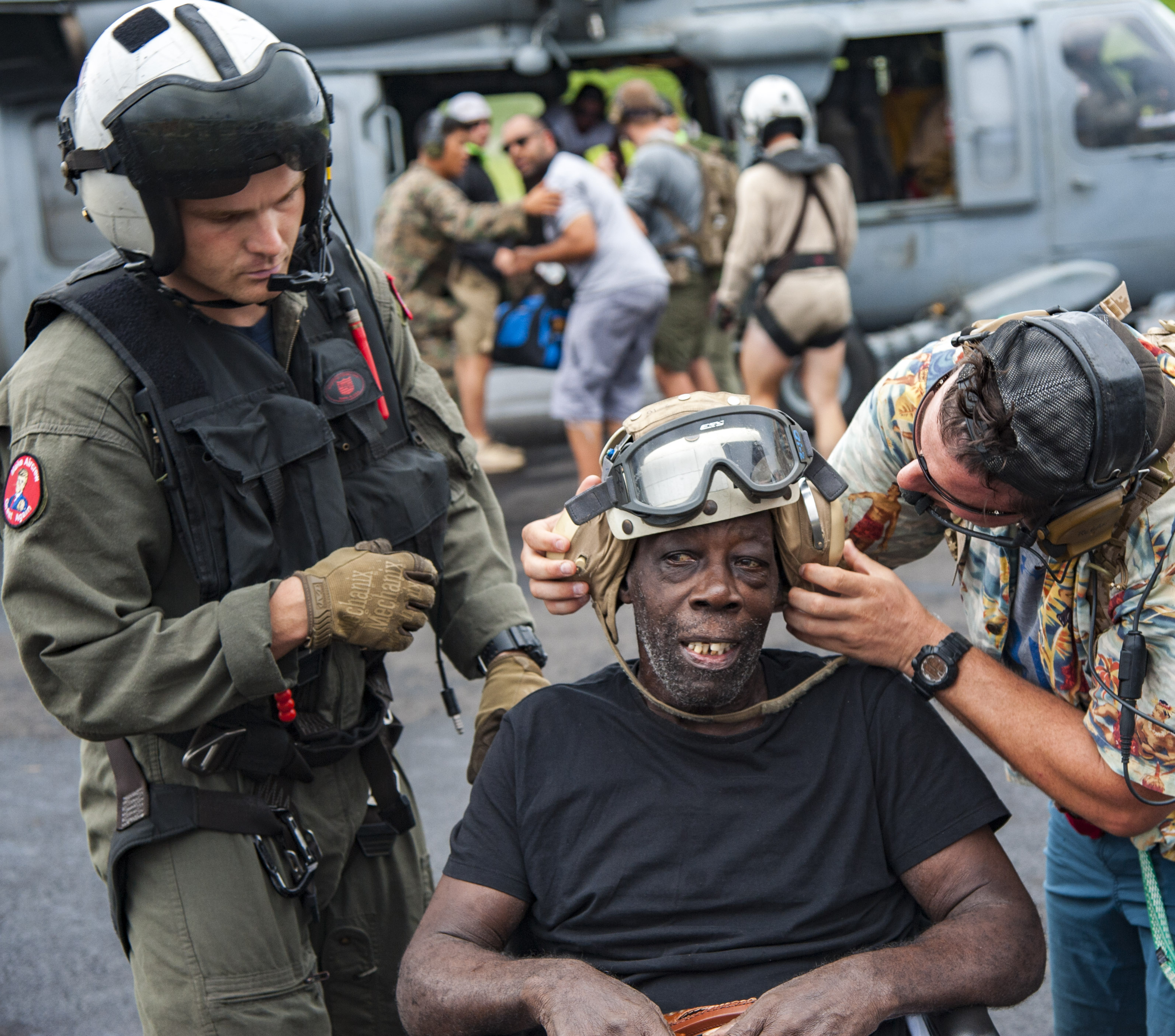 In this U.S. Navy handout, Naval Aircrewman (Helicopter) 2nd Class Nicholas Glass, assigned to Helicopter Sea Combat Squadron (HSC) 22 aboard to the amphibious assault ship USS Wasp (LHD 1), prepares a resident for evacuation following the landfall of Hurricane Maria on September 28, 2017. Photo by Mass Communication Specialist Seaman Taylor King/U.S. Navy via Getty Images