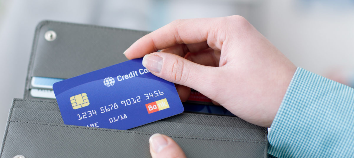 A woman uses her credit card. Shutterstock image via stokkete