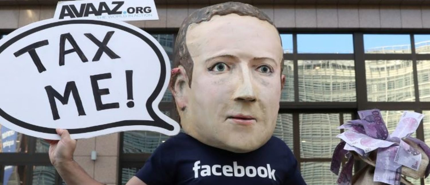 An activist wearing a mask depicting Facebook's CEO Mark Zuckerberg demonstrates during the European Union finance ministers meeting, outside the EU headquarters in Brussels, Belgium, December 4, 2018. REUTERS/Yves Herman