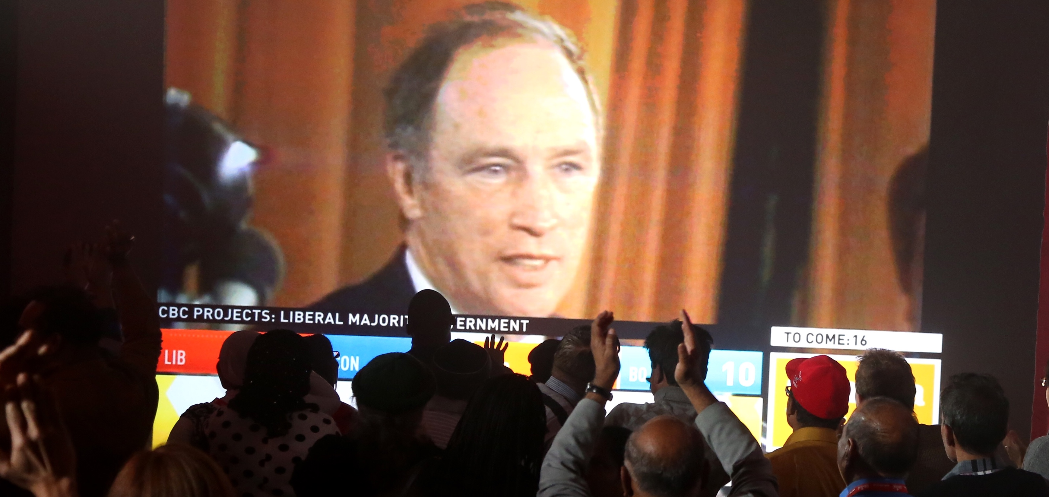 An image of former Canadian Prime Minister Pierre Trudeau is shown on a screen as Liberal Party supporters cheer as they watch results during Canada's federal election in Montreal, Quebec, October 19, 2015. REUTERS/Christinne Muschi