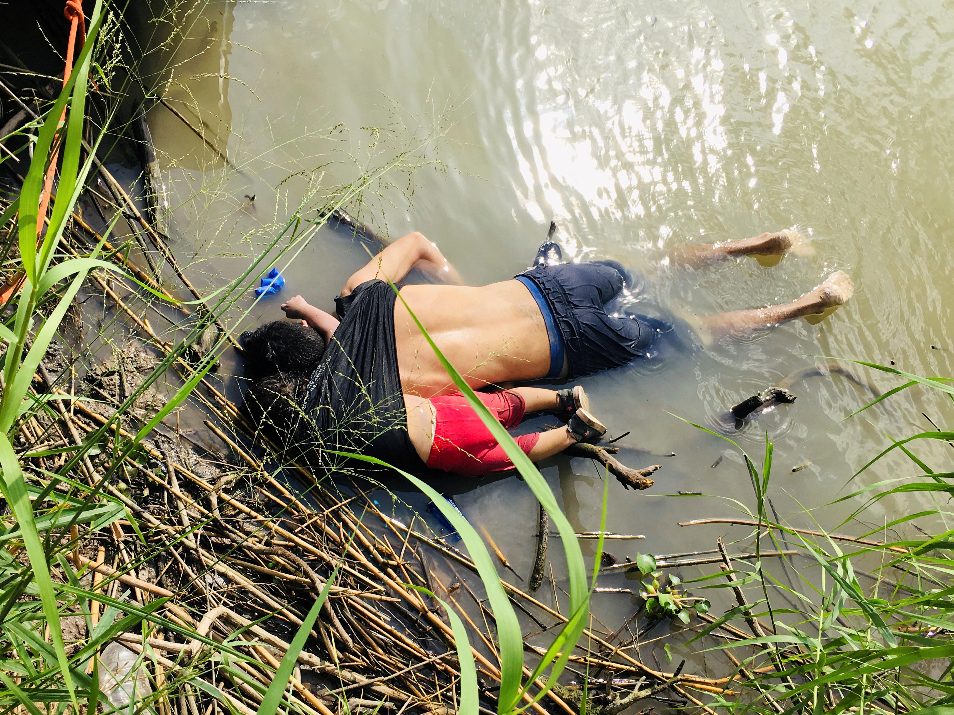 The bodies of Salvadoran migrant Oscar Alberto Martinez Ramirez and his daughter Valeria lie in the Rio Bravo river in Matamoros, in Tamaulipas state, Mexico June 24, 2019. REUTERS/Stringer