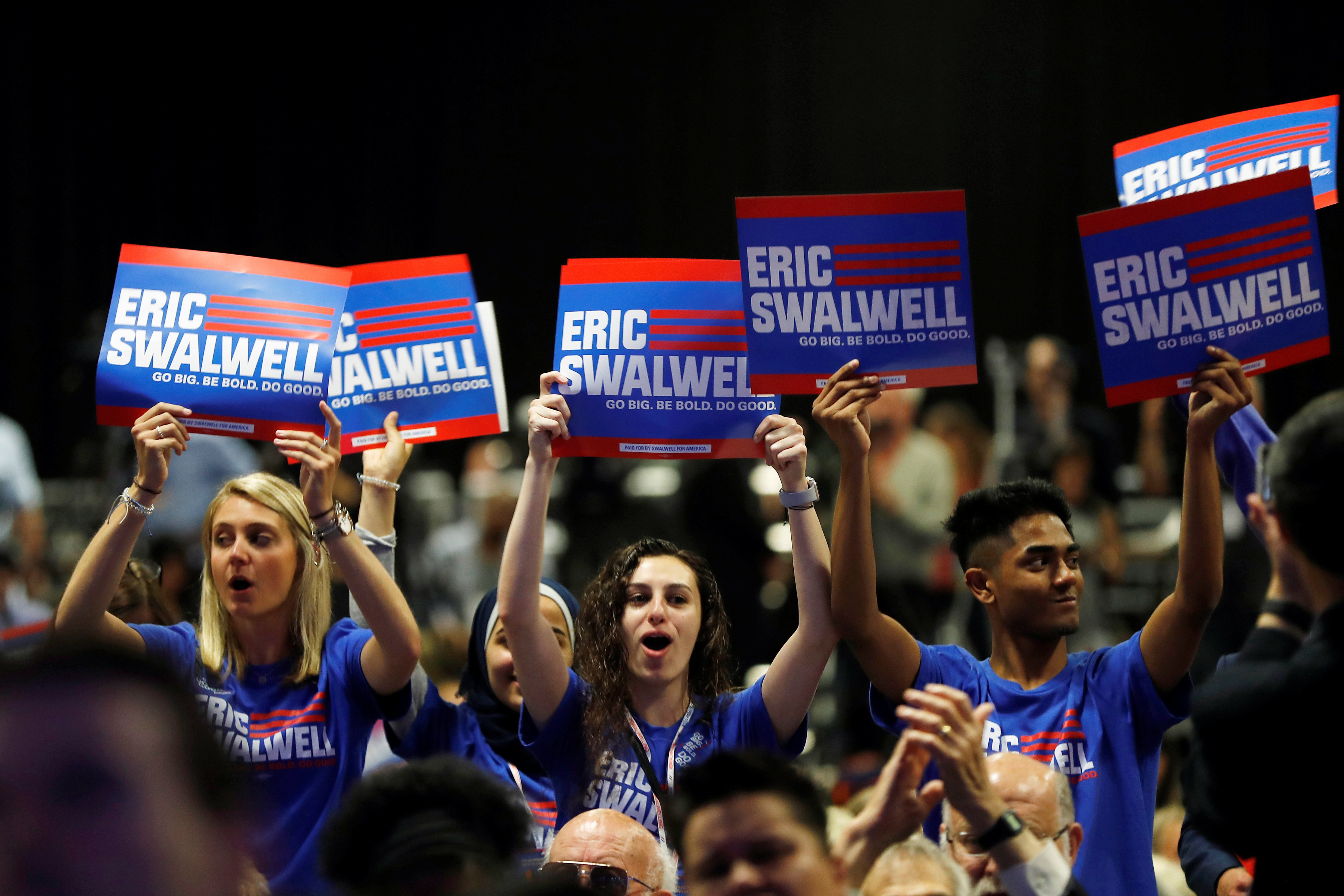 Supporters of Democratic U.S. presidential candidate U.S. Representative Eric Swalwell (D-CA) chant during the California Democratic Convention in San Francisco, California, U.S. June 1, 2019. REUTERS/Stephen Lam