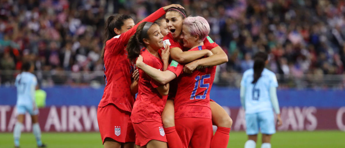 REIMS, FRANCE - JUNE 11: Alex Morgan of the USA celebrates with teammates after scoring her team's twelfth goal during the 2019 FIFA Women's World Cup France group F match between USA and Thailand at Stade Auguste Delaune on June 11, 2019 in Reims, France. (Photo by Robert Cianflone/Getty Images)