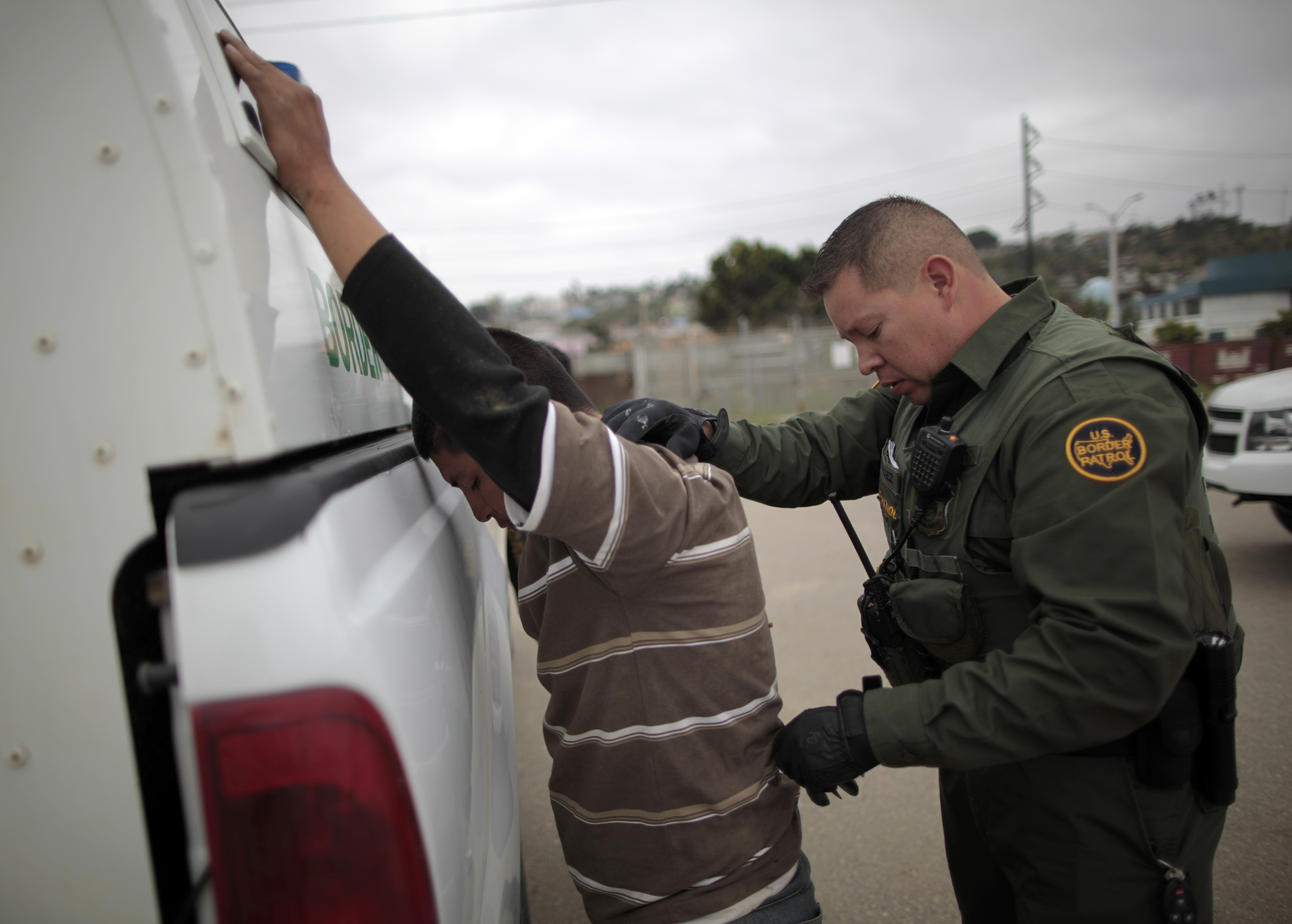 A United States border patrol agent catches an illegal immigrant crossing from Mexico to the U.S. in San Ysidro