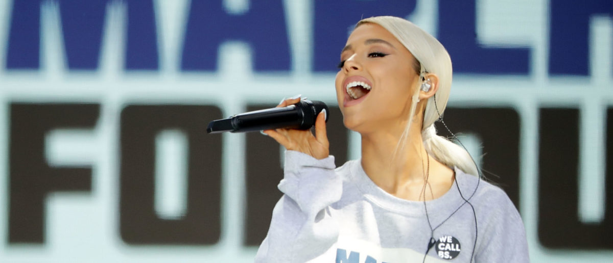 "Ariana Grande performs ""Be Alright"" during the March for Our Lives rally on March 24, 2018 in Washington, DC. Hundreds of thousands of demonstrators, including students, teachers and parents gathered in Washington for the anti-gun violence rally organized by survivors of the Marjory Stoneman Douglas High School shooting on February 14 that left 17 dead. More than 800 related events are taking place around the world to call for legislative action to address school safety and gun violence. (Photo by Chip Somodevilla/Getty Images)"